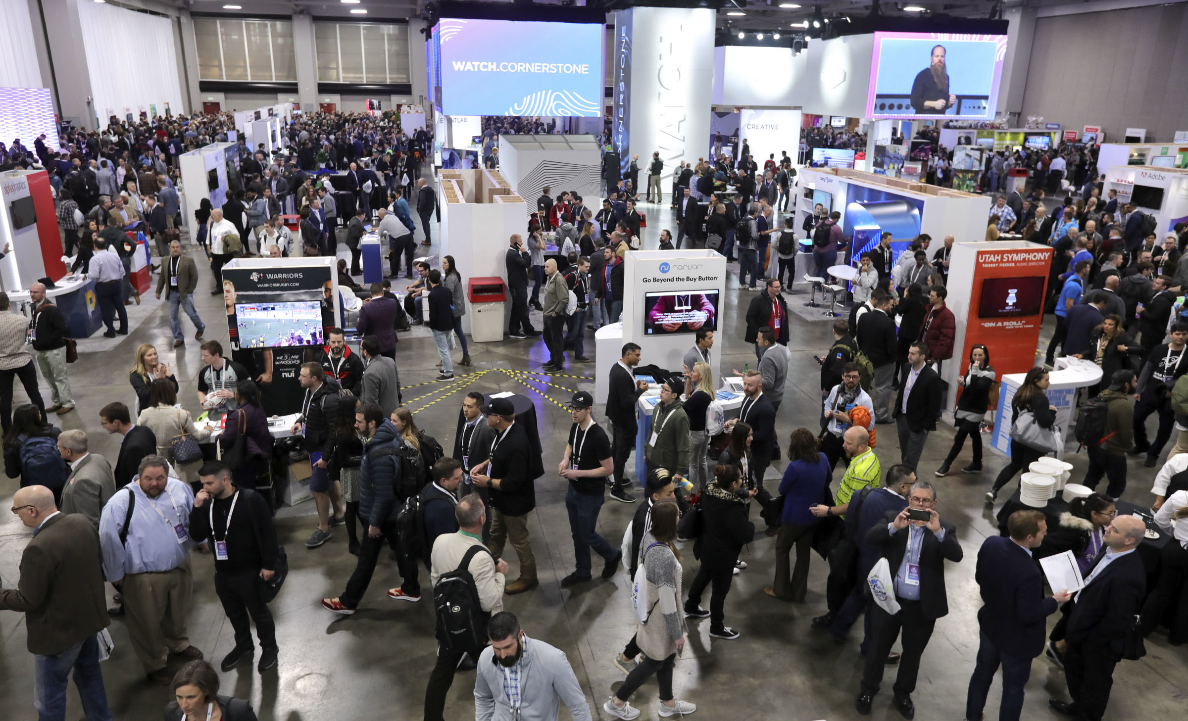Crowds move through the Silicon Slopes Tech Summit at the Salt Palace Convention Center in Salt Lake City on Thursday, Jan. 31, 2019.