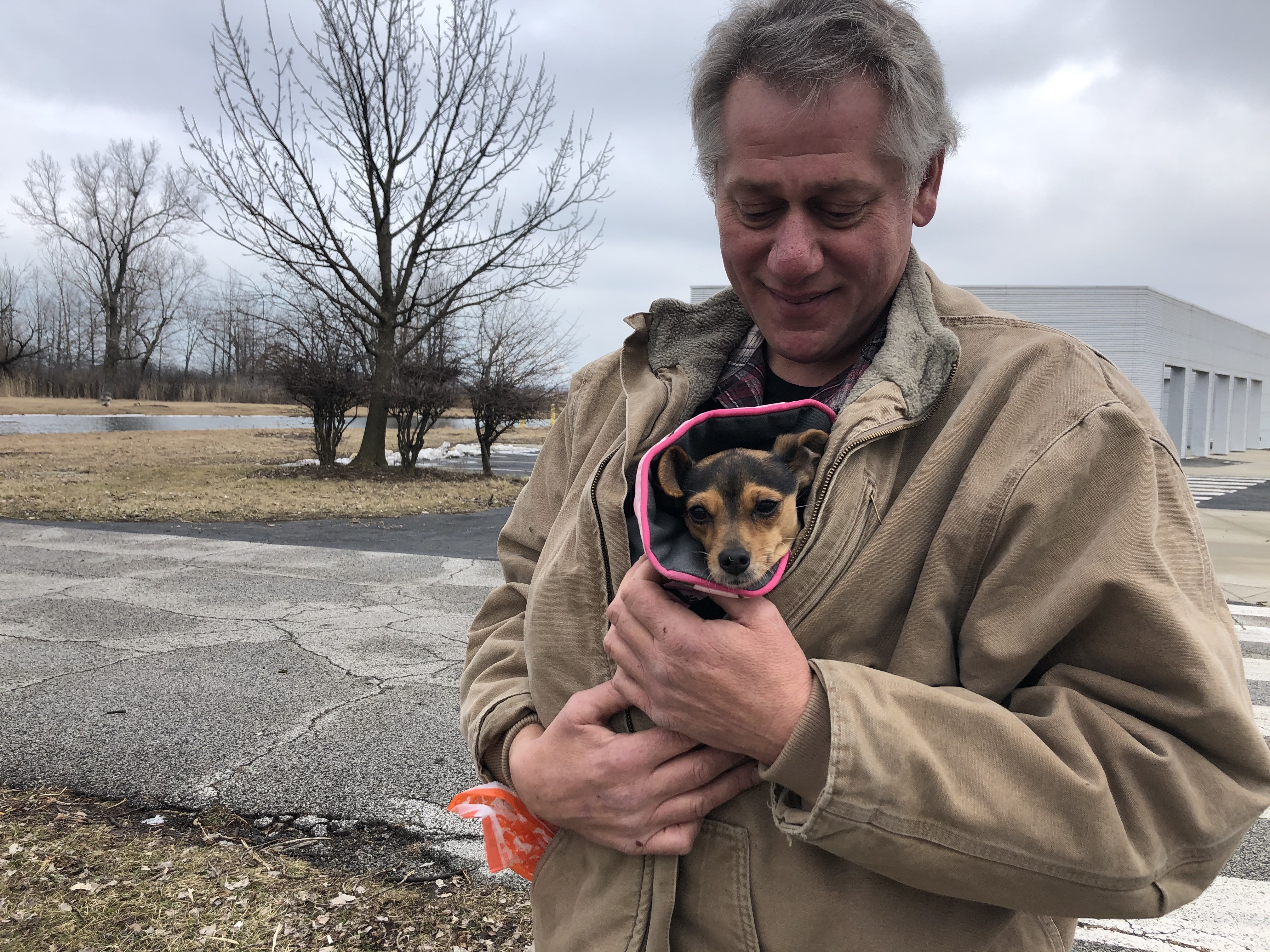 Chicago Police Officer George Davros and newly-adopted Eva stay warm while on a walk near his home.