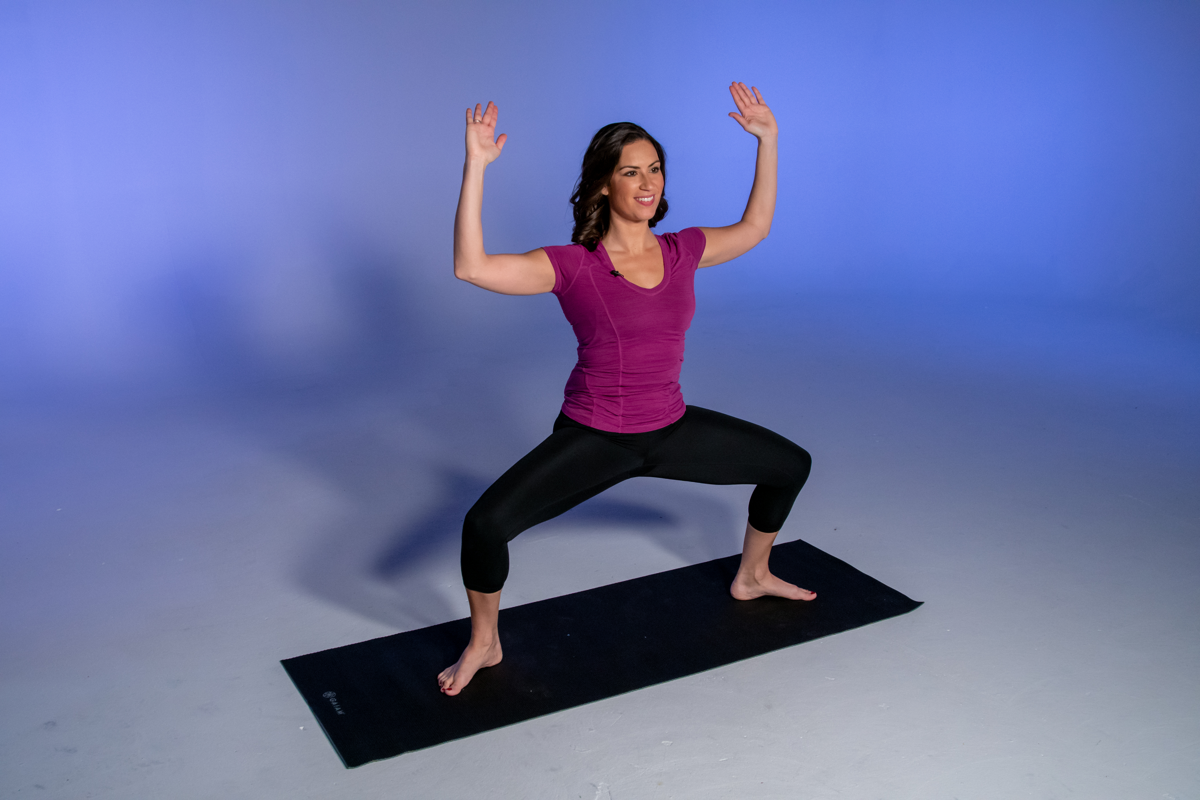 Health and fitness expert Stephanie Mansour demonstrates the first step in a bright goddess yoga pose.
