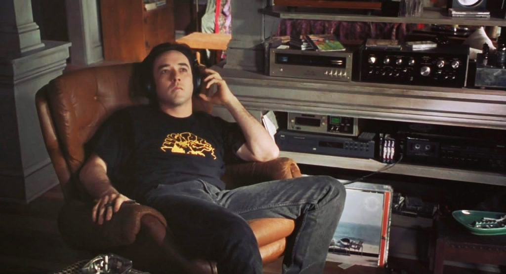 John Cusack in High Fidelity, appreciating some vinyl.