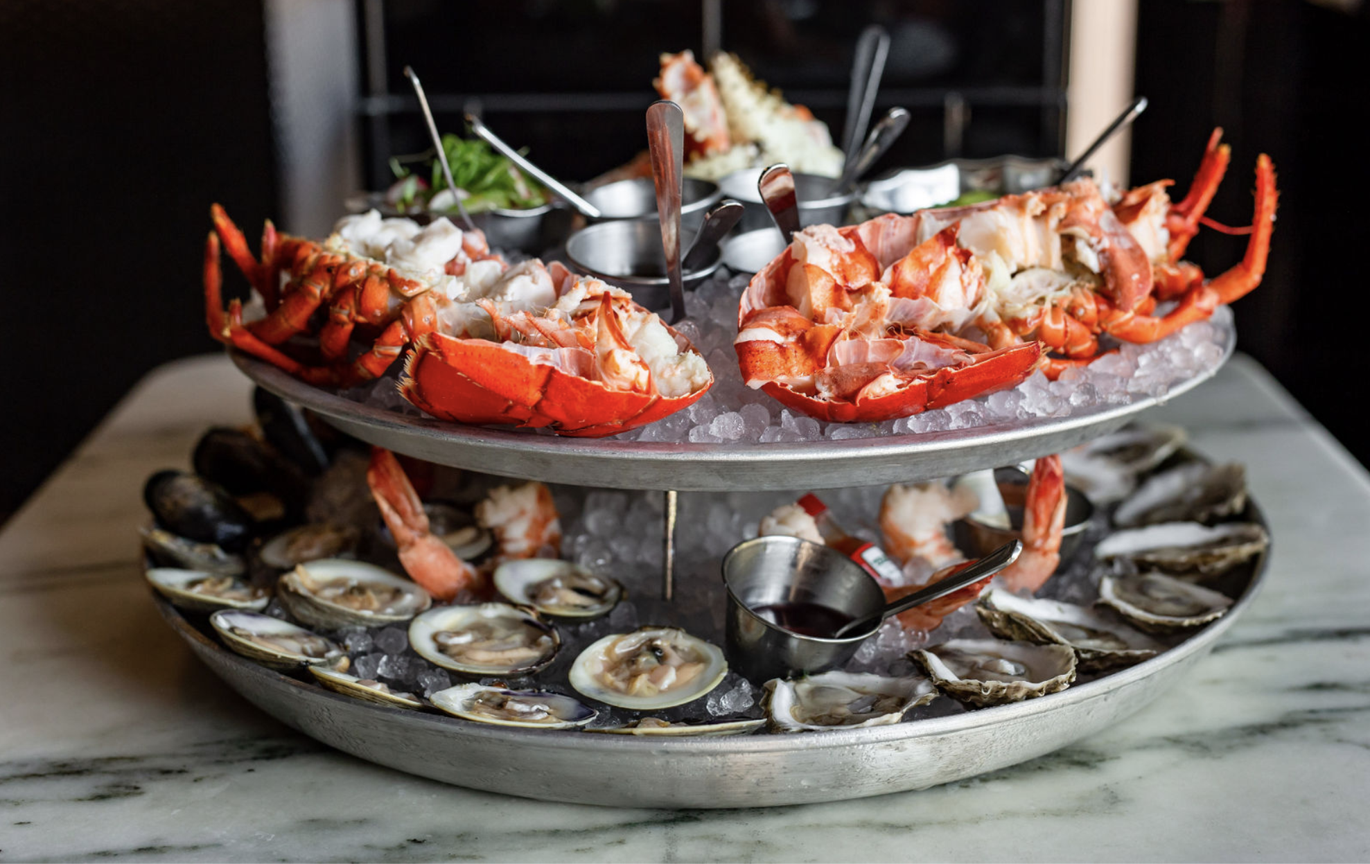 seafood tower with oysters, clams, and lobster tail