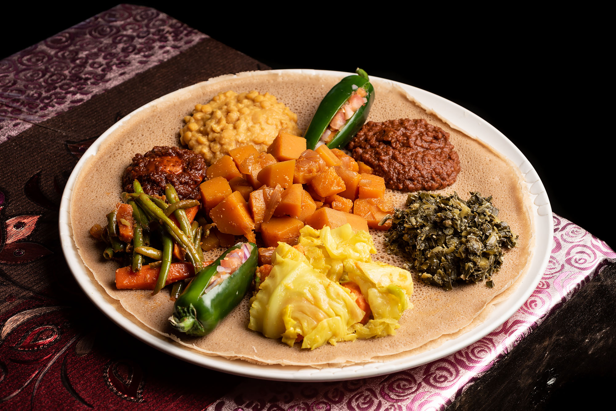 A platter of colorful Ethiopian stews on injera bread.