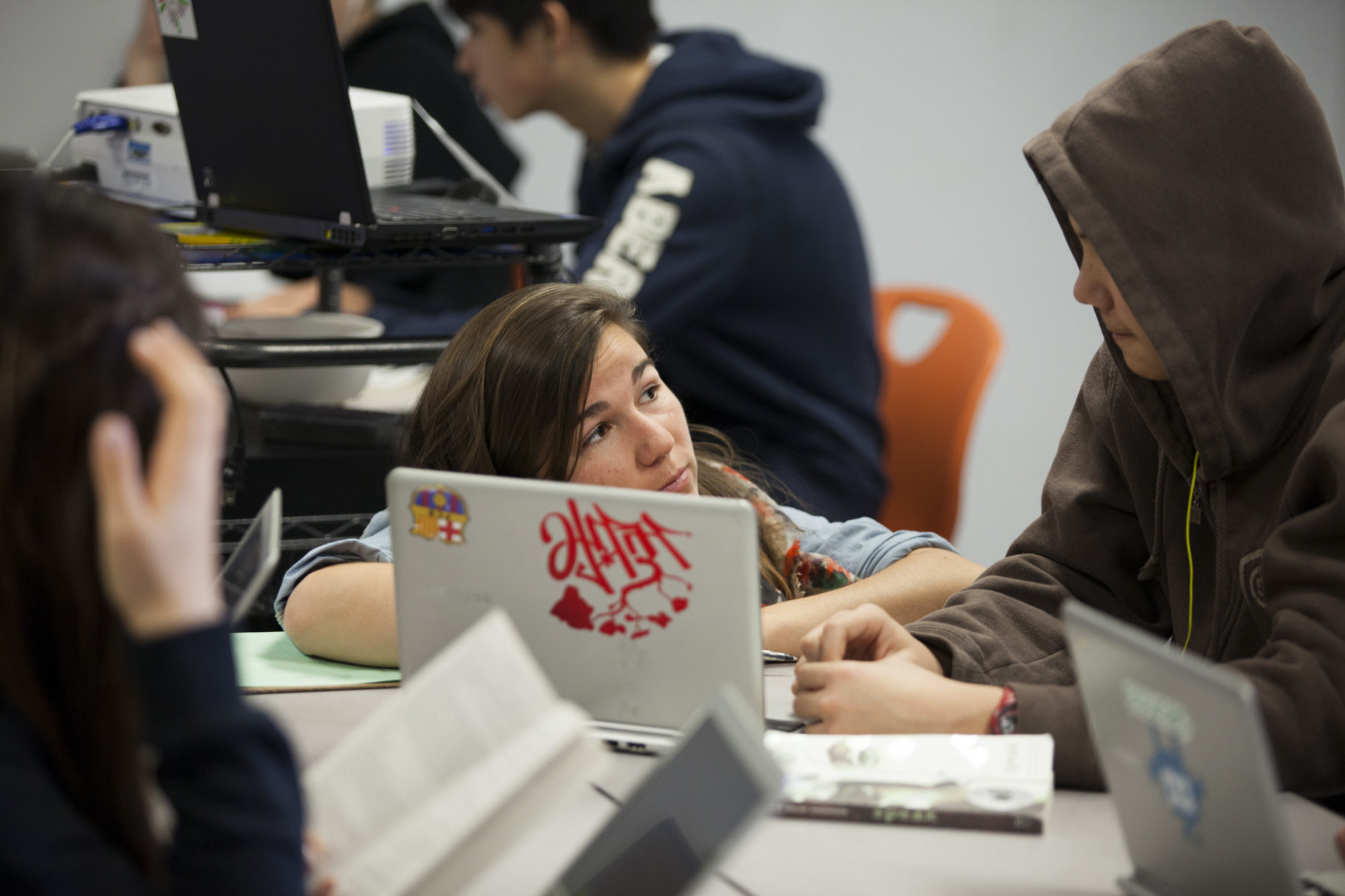 English teacher Adelaide Giornelli works with ninth grade students on computers at Shasta charter public high school, part of the Summit public school system. (Photo by Melanie Stetson Freeman/The Christian Science Monitor via Getty Images)