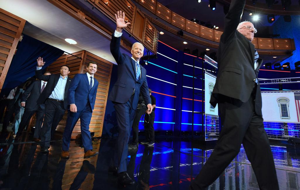 Democratic presidential candidates Andrew Yang, South Bend Mayor Pete Buttigieg, former U.S. vice president Joe Biden, and Sen. Bernie Sanders take the stage for the first Democratic presidential primary debate for the 2020 election.