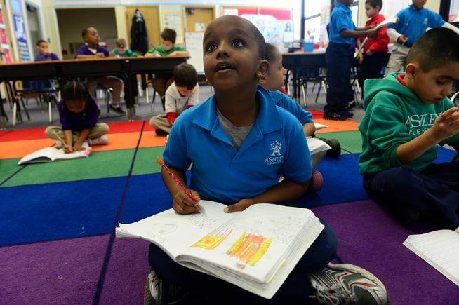Five-year-old Samatar Abhullahi works during his kindergarten class at Denver's Ashley Elementary School.