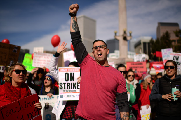 DJ Bruen, a teacher at Johnson Elementary School, gathers with other teachers and their supporters at a rally in Civic Center Park on the second day of the Denver teacher strike.