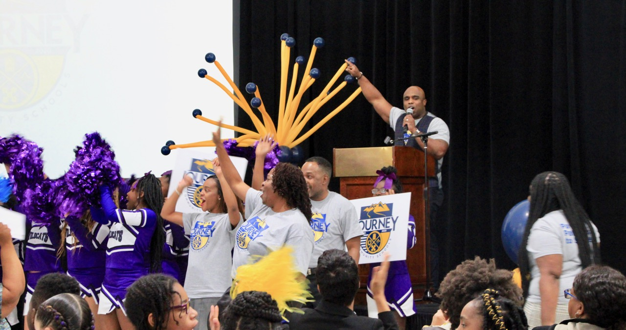 """Aspire leader Nickalous Manning asked the group of students and community leaders, """"Are you ready to find out who we are?"""" He will remain in leadership as the charter network transitions."""