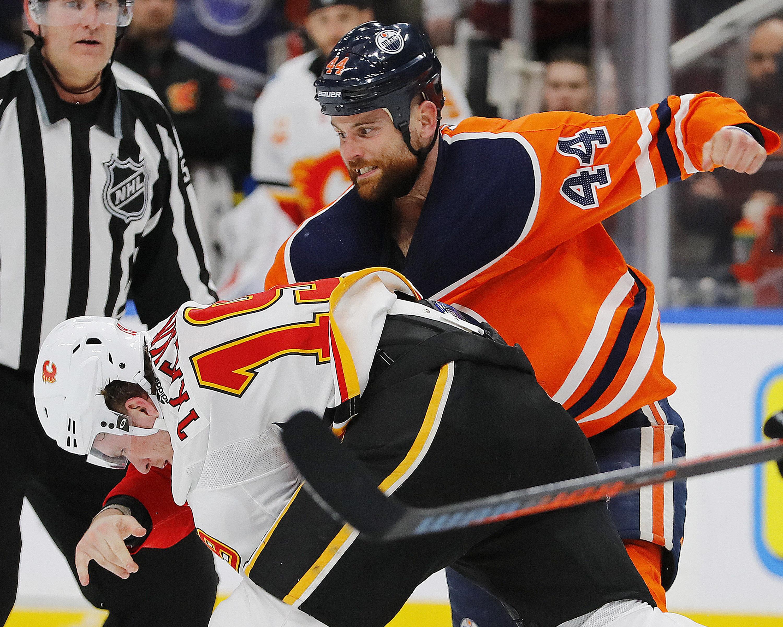 Jan 29, 2020; Edmonton, Alberta, CAN; Edmonton Oilers forward Zack Kassian (44) and Calgary Flames forward Matt Tkachuk (19) fight during the first period at Rogers Place.