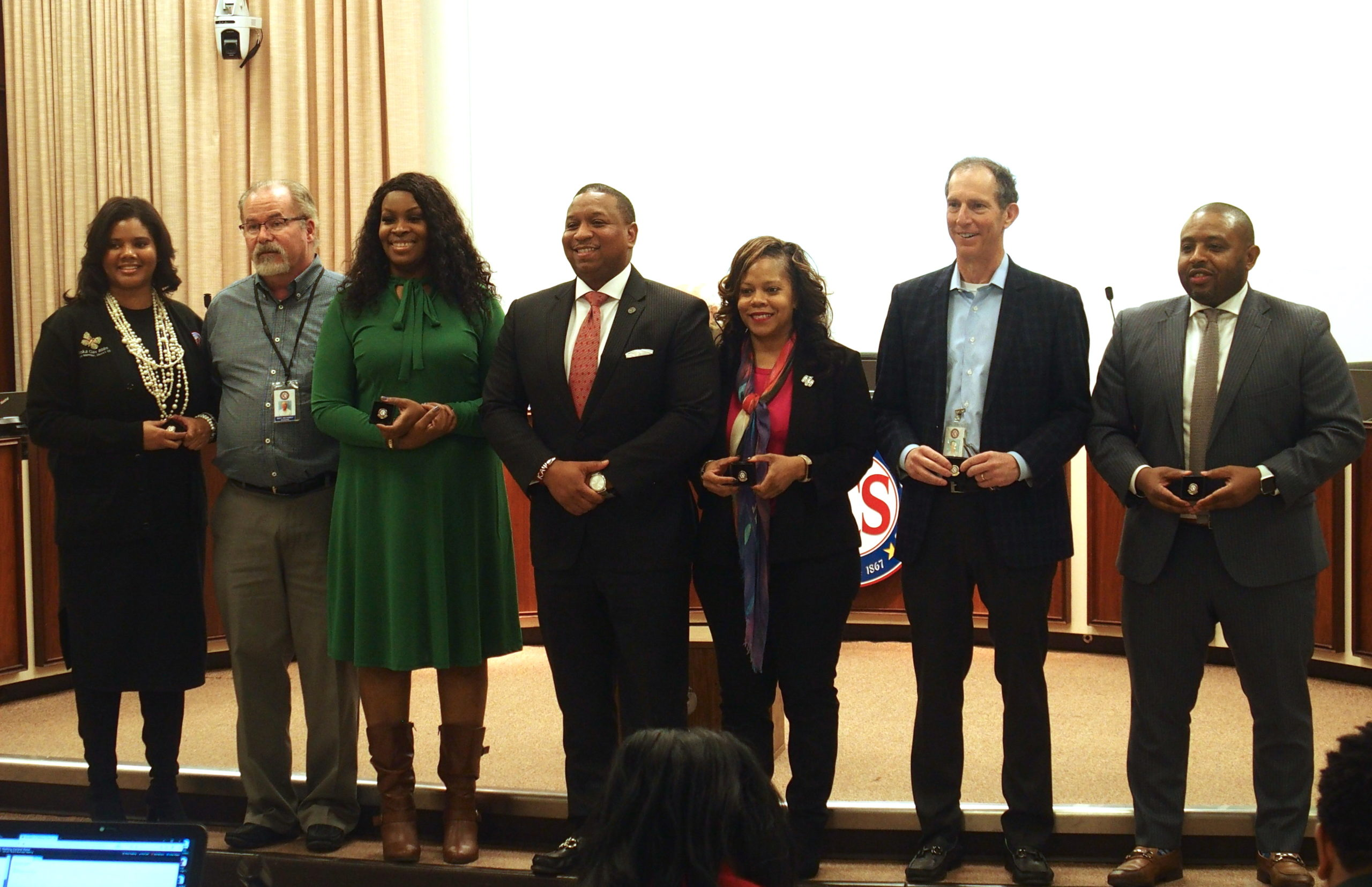 Superintendent Joris Ray, center, honors long-serving school board members at a meeting last week. From left, Miska Clay Bibbs, Scott McCormick, and Stephanie Love are up for re-election this year. Shante Avant and Billy Orgel won re-election in 2018. Kevin Woods, right, is not seeking re-election.