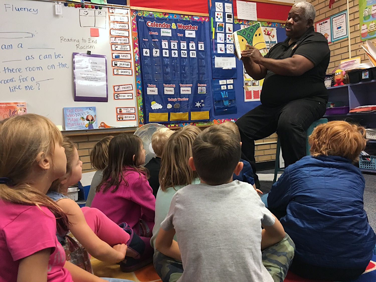"""James Johnson, reads """"Mr. Happy"""" to first-graders at Flatirons Elementary as part of the Reading to End Racism program."""