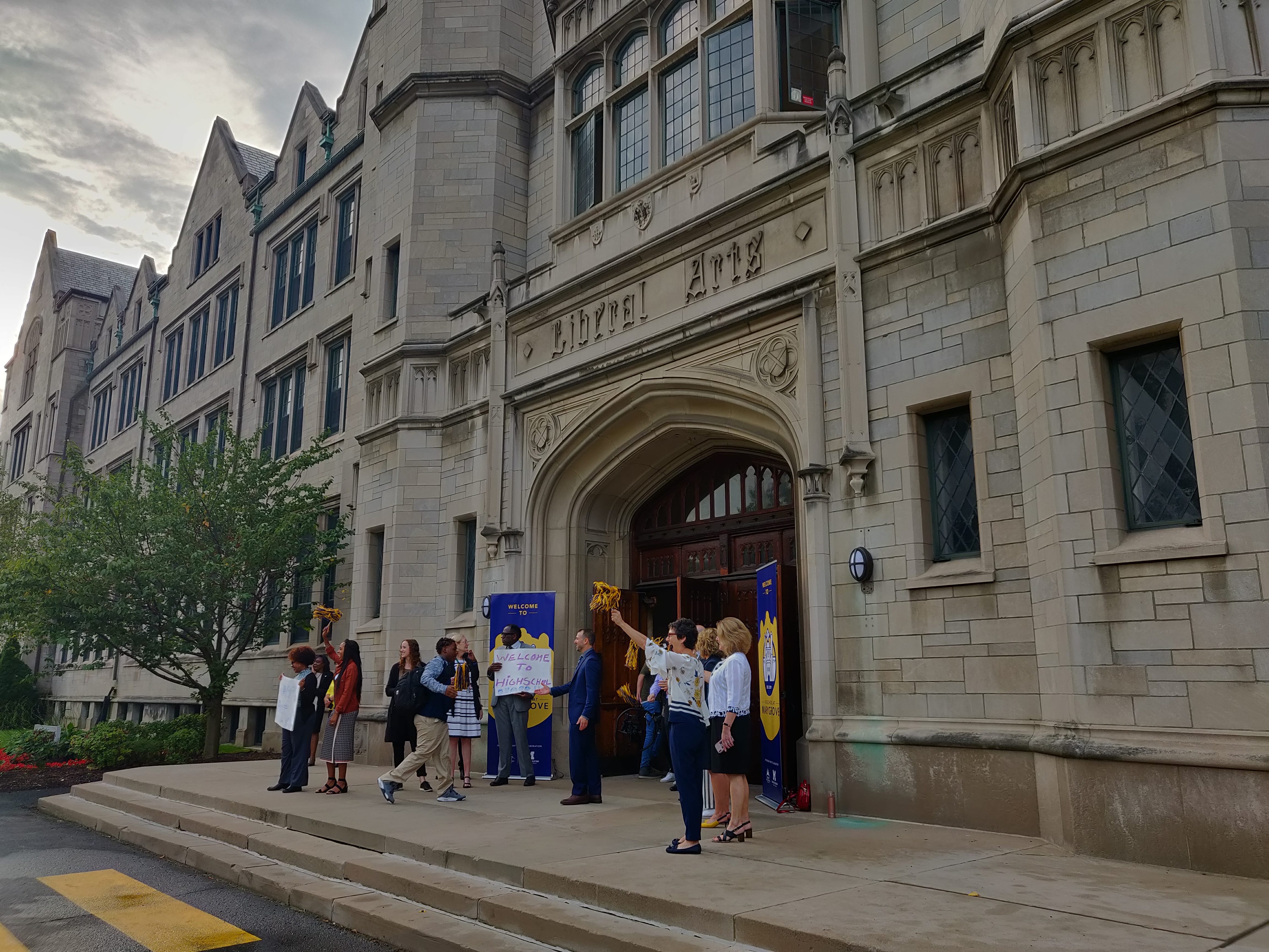 Students attending The School at Marygrove are welcomed to class Tuesday morning on the first day of school.