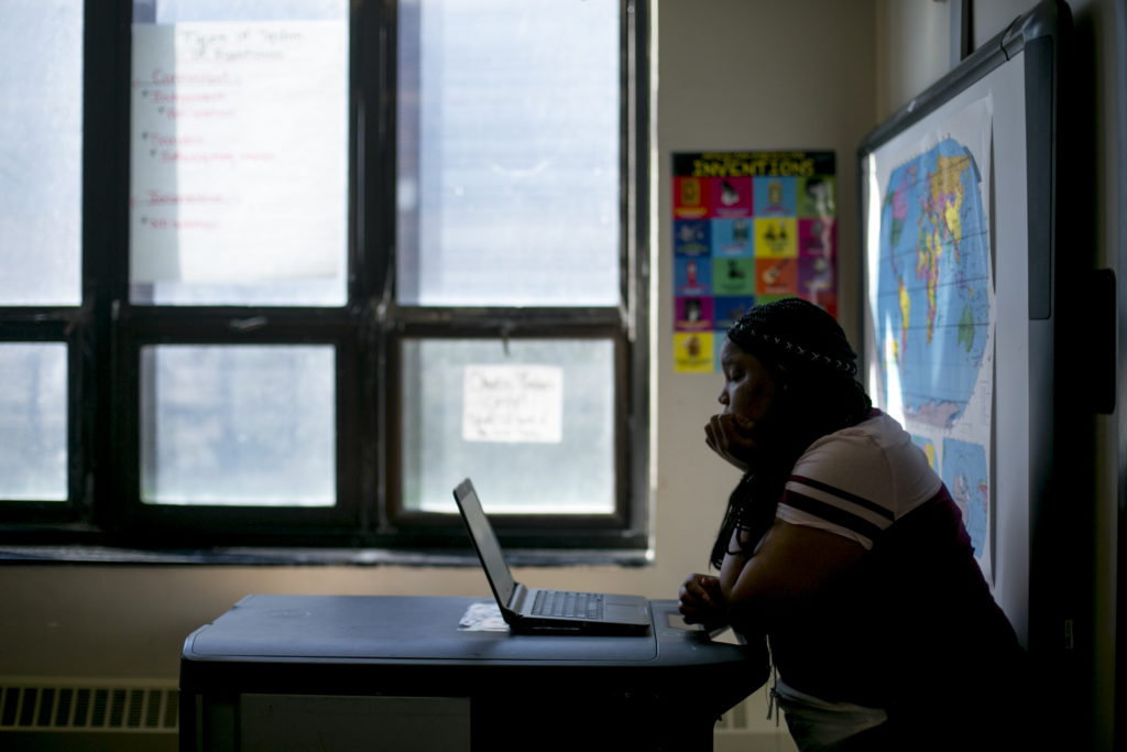 A high school student works on a laptop in a math class at Detroit Public Schools. The district uses Khan Academy to prepare students to take the PSAT and SAT tests.