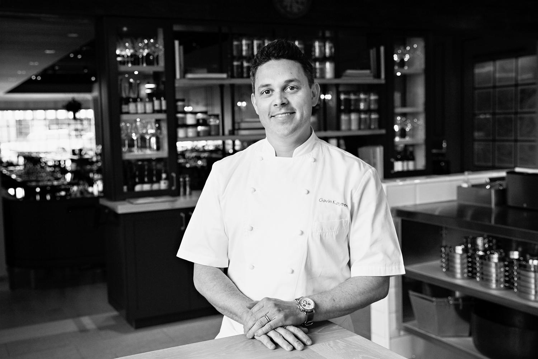 A black and white photo of Gavin Kaysen