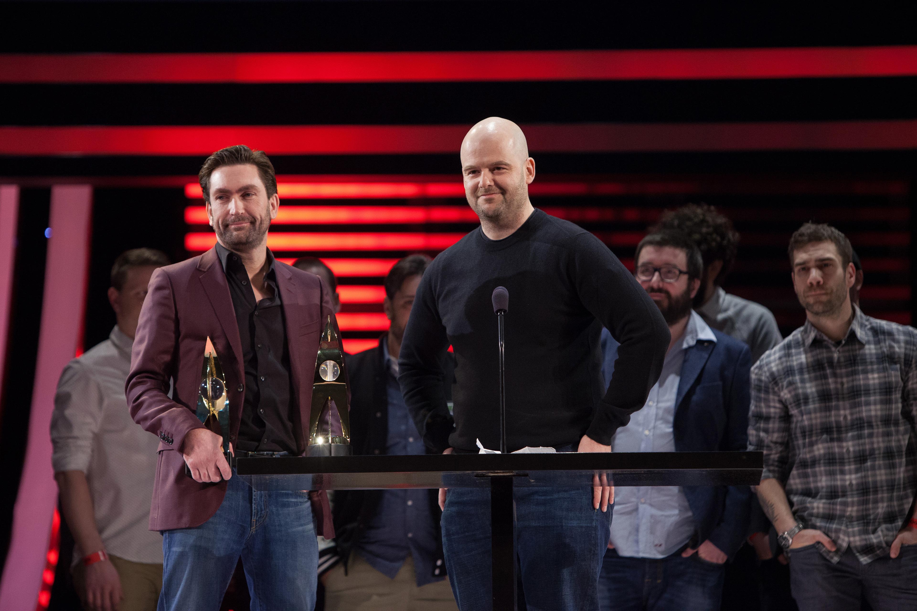 photo of Leslie Benzies and Dan Houser behind a podium at DICE 2014