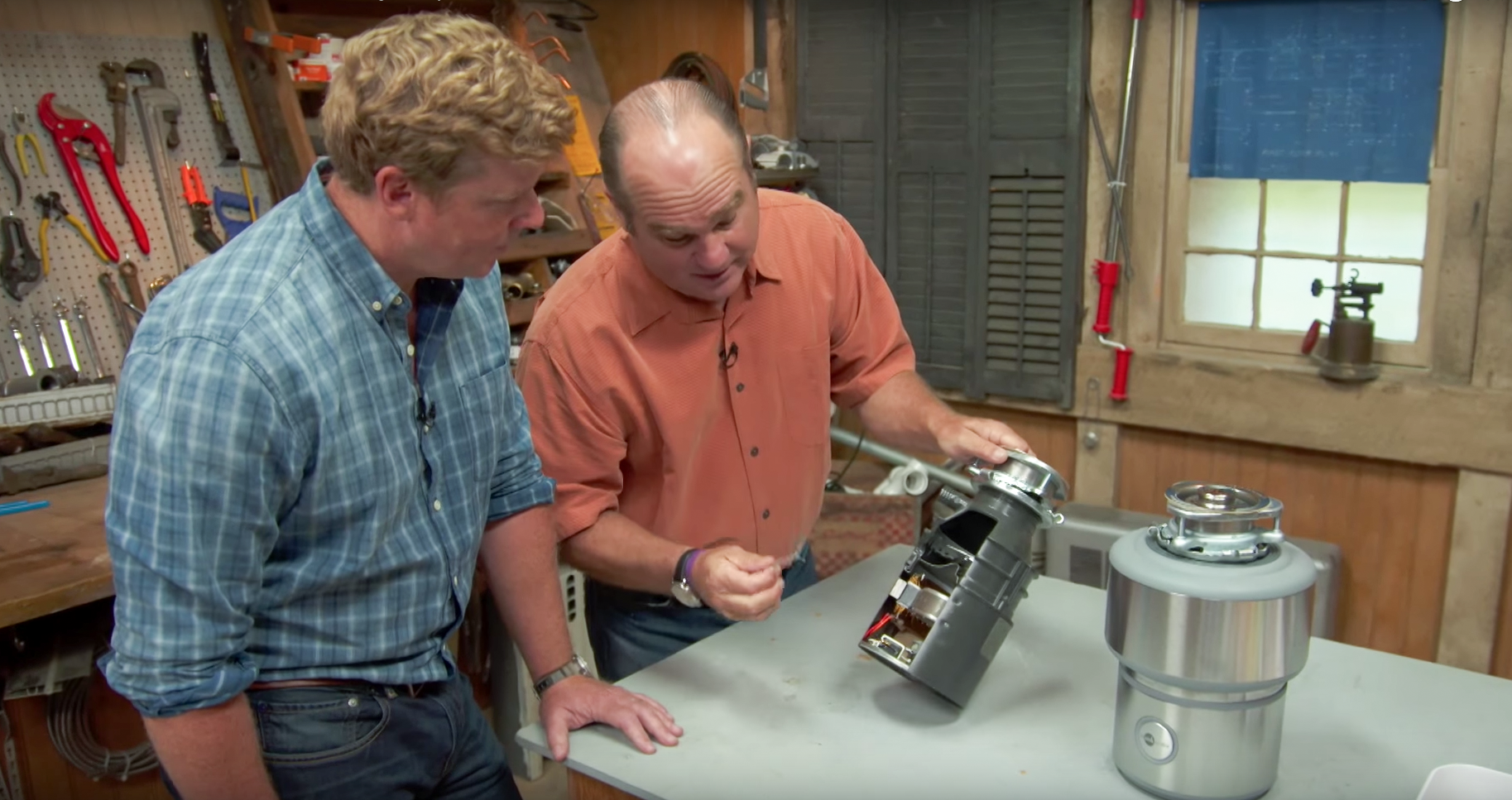 Richard Trethewey and Kevin O'Connor work on a garbage disposal
