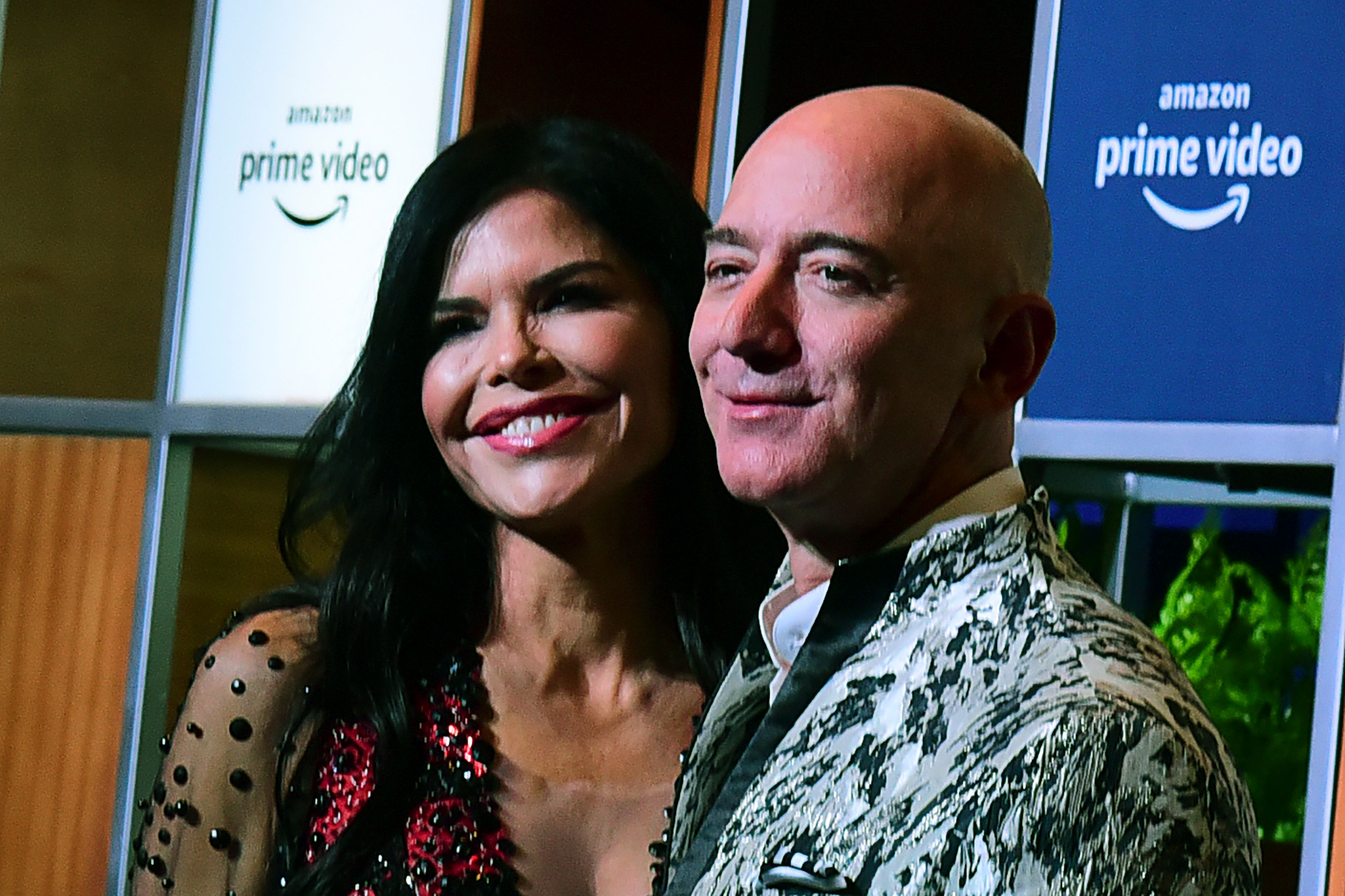 Amazon CEO Jeff Bezos poses for a photo at an Amazon event with his girlfriend, Lauren Sanchez.