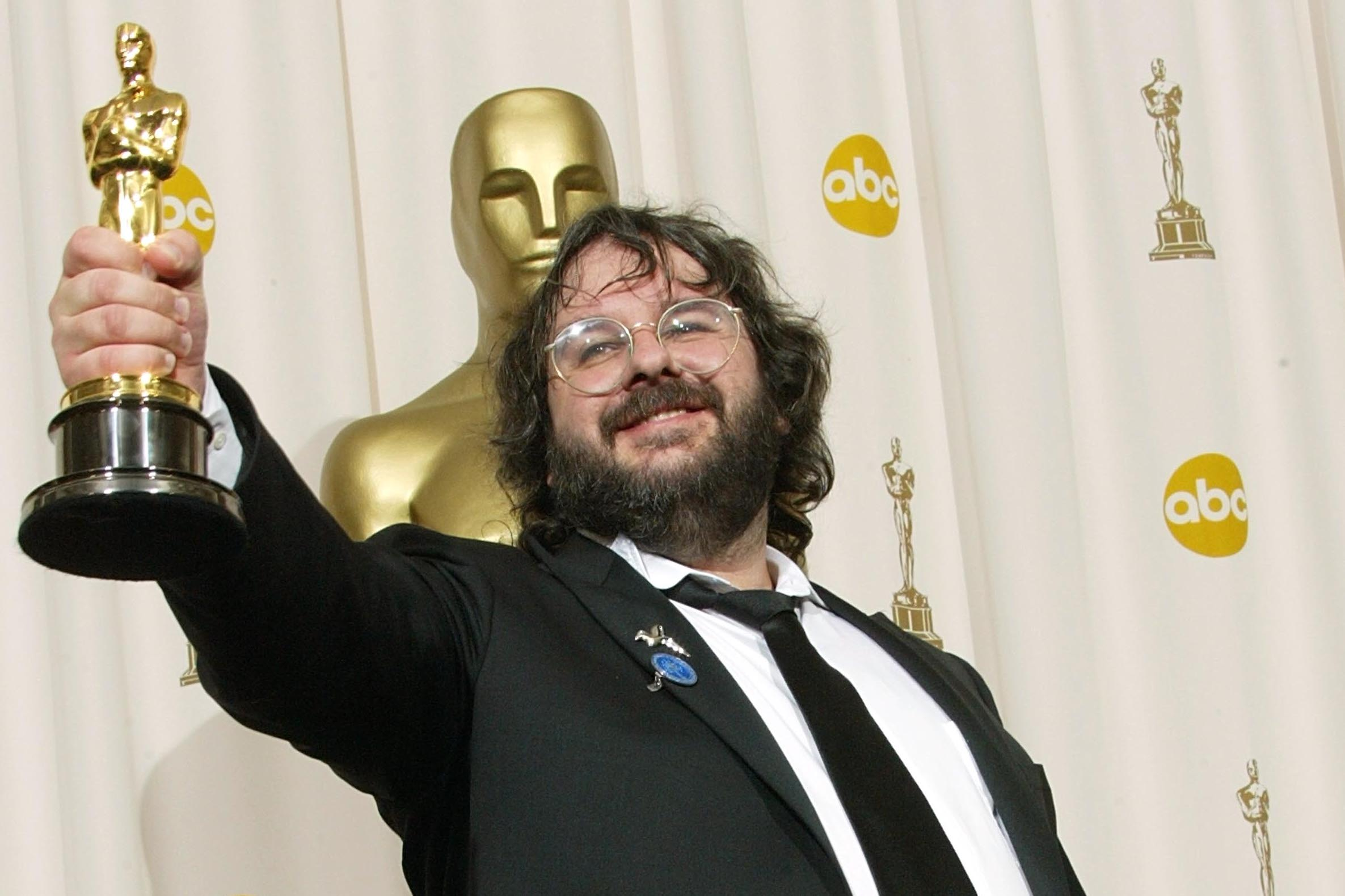 """Peter Jackson holds up his Oscar, smiles, and thinks """"Lord of the Rings rules!"""""""