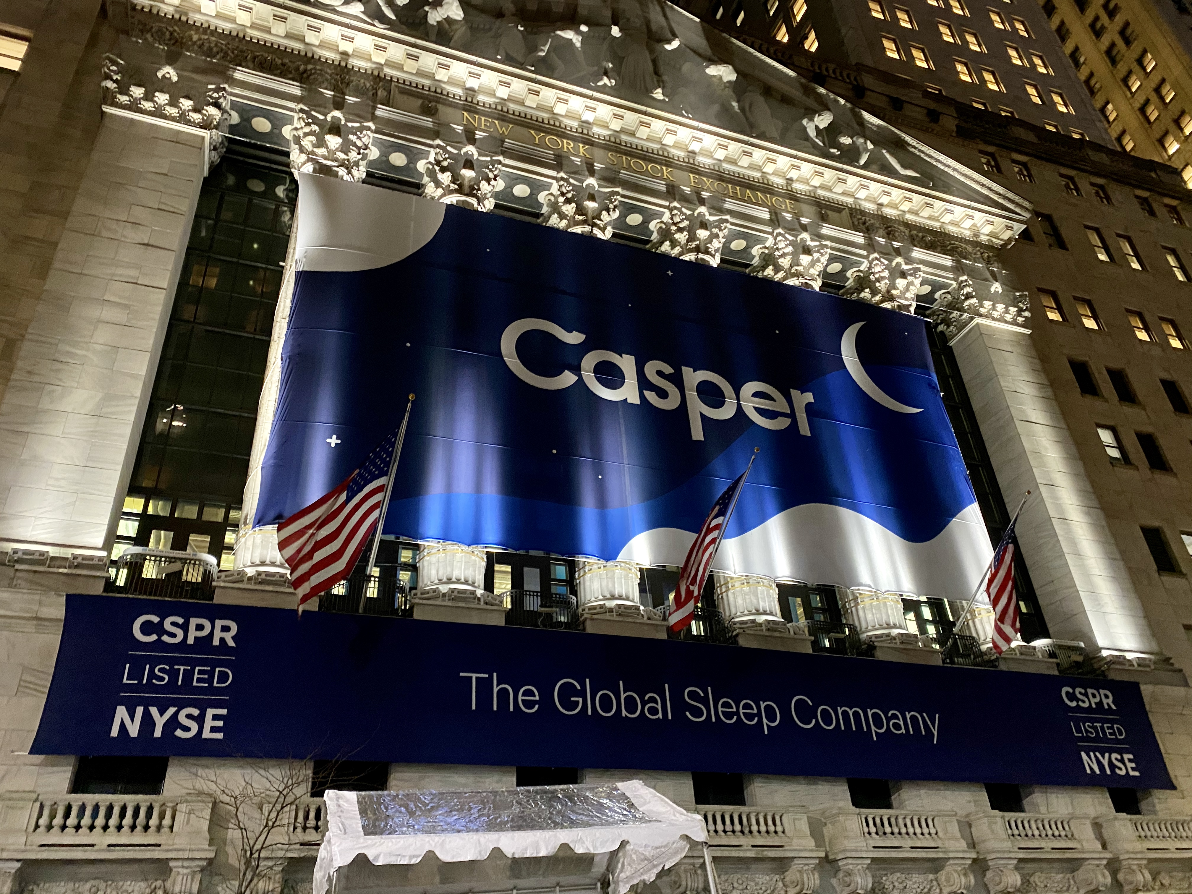 A Casper Sleep banner covers the front of the New York Stock Exchange the night before its IPO.