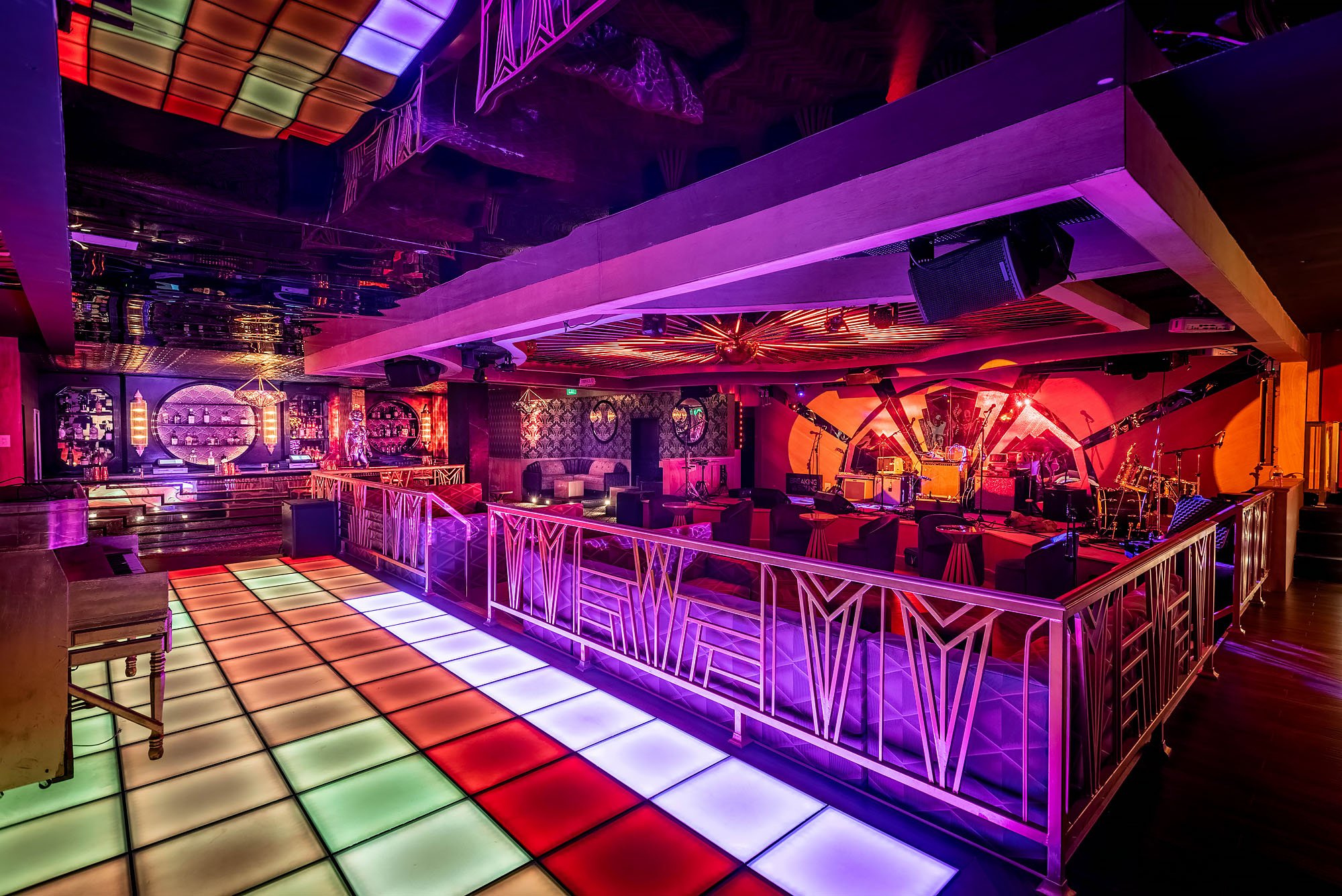 Colorful multi-paneled dance floor and stage at Kiss Kiss Bang Bang, Koreatown, Los Angeles.