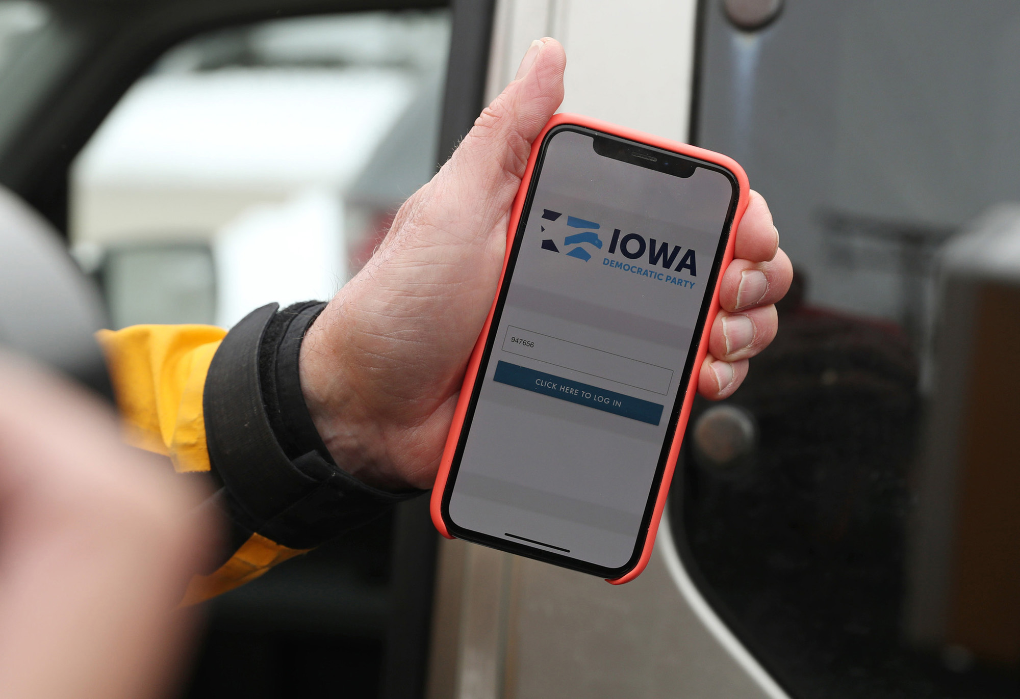 A precinct chair shows the 2020 Iowa Caucus mobile app on his phone.