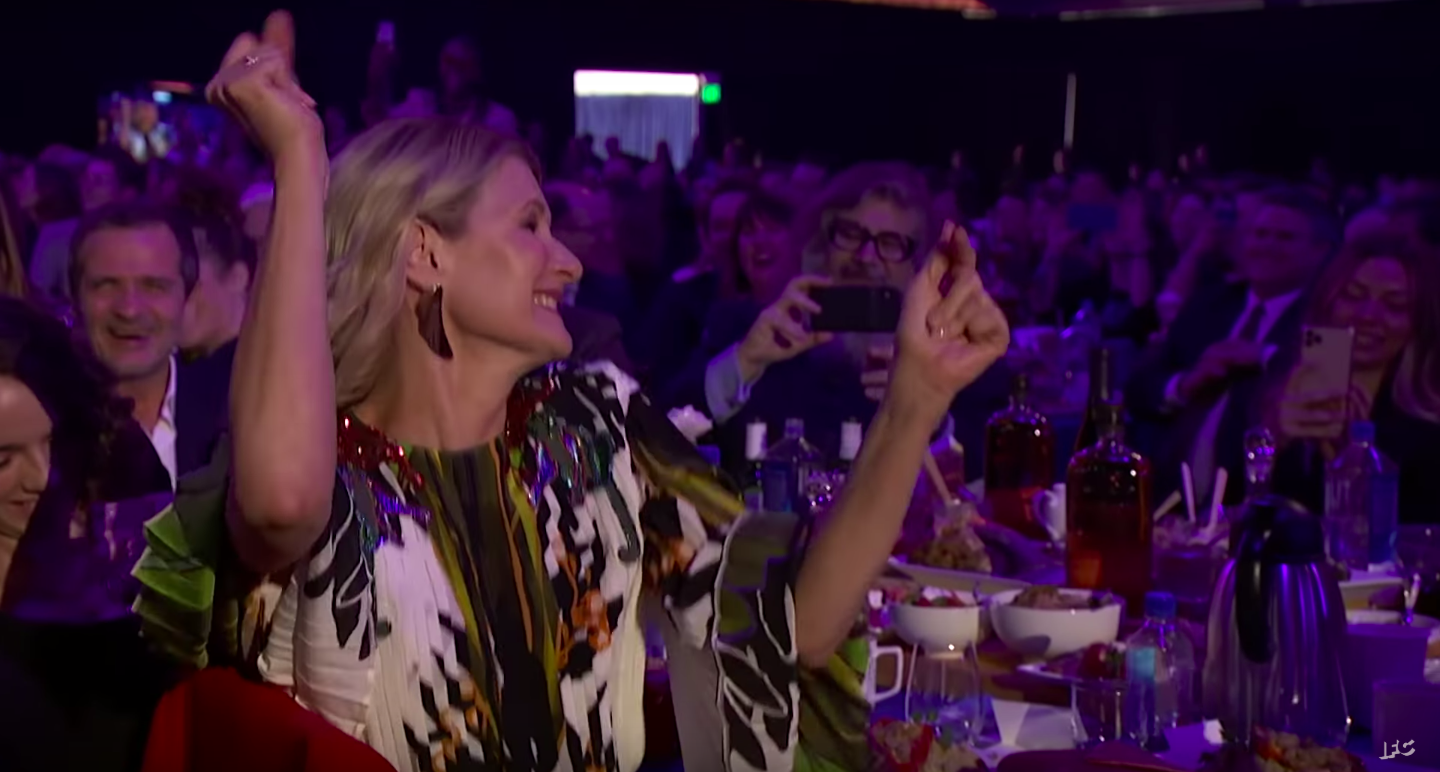 Laura Dern dances as the Gay Men's Chorus of Los Angeles performs at the 2020 Independent Spirit Awards