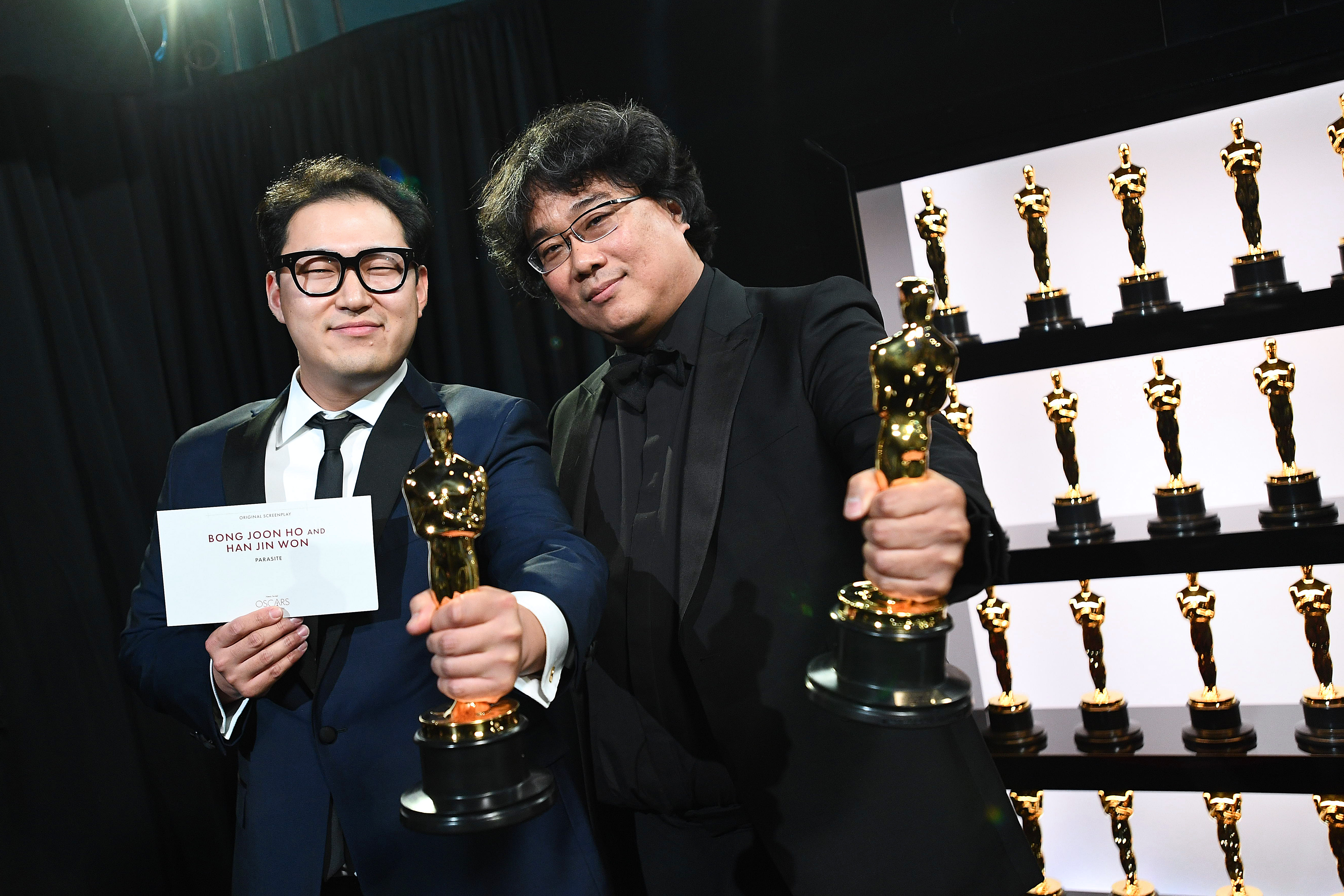Best Original Screenplay award winners Han Jin Won and Bong Joon Ho pose backstage during the 92nd Annual Academy Awards at the Dolby Theatre on February 09, 2020 in Hollywood, California.