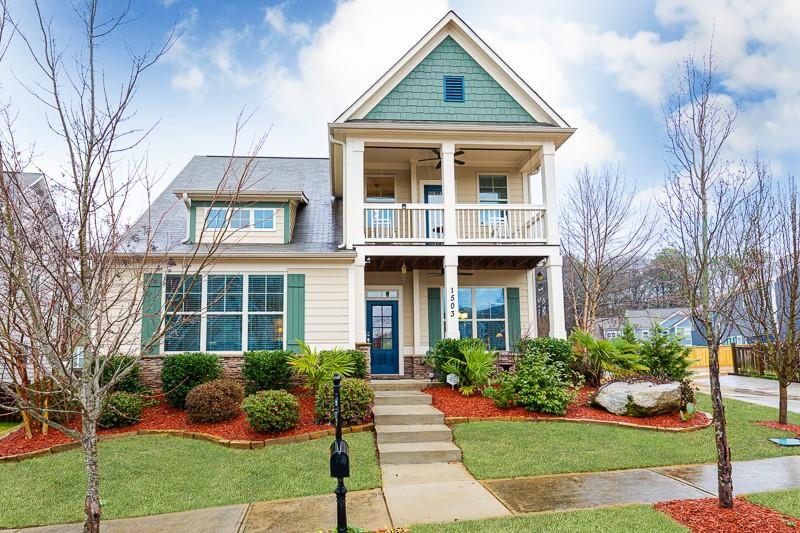 A tall yellow house with blue accents.