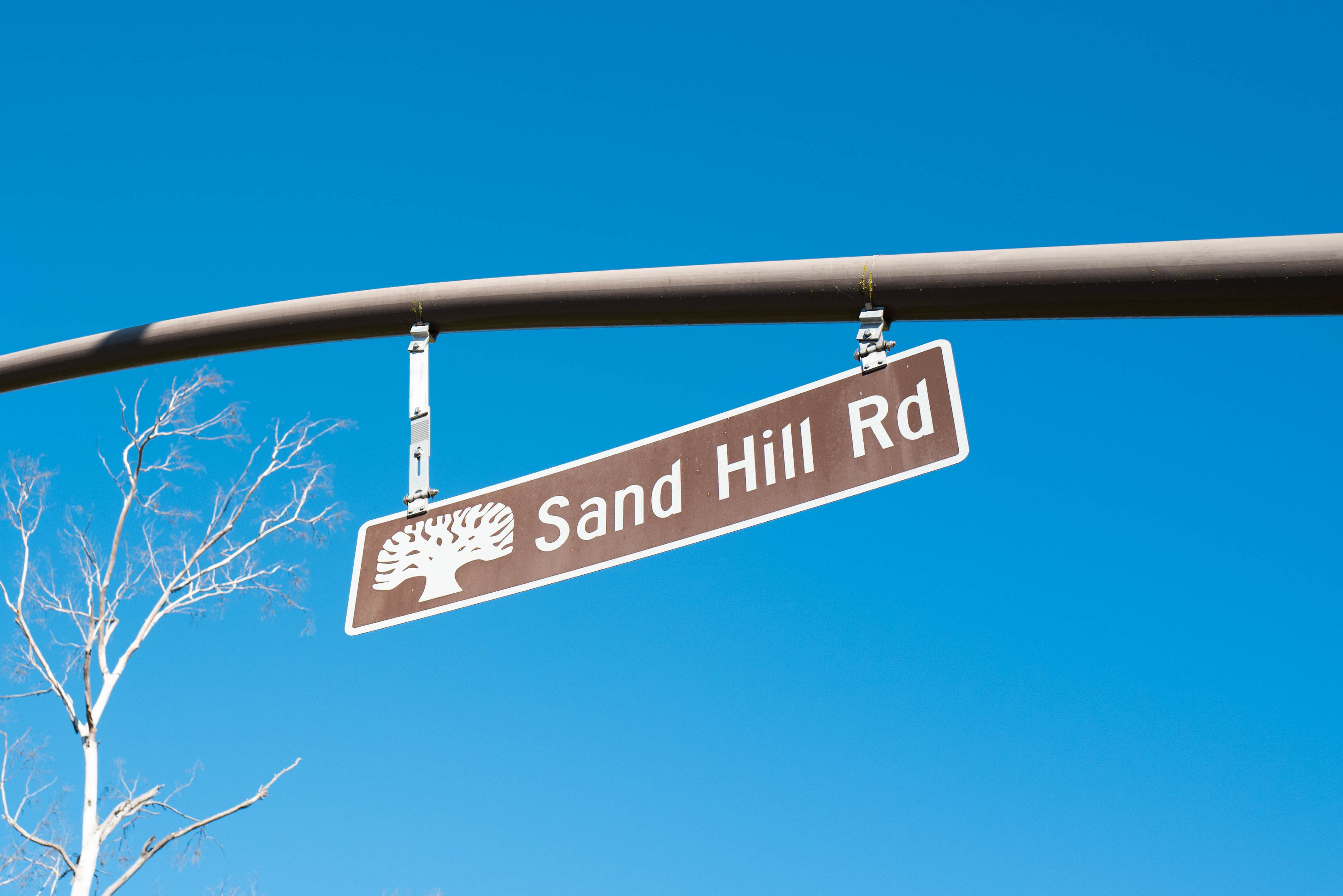 A street sign that reads Sand Hill Road.