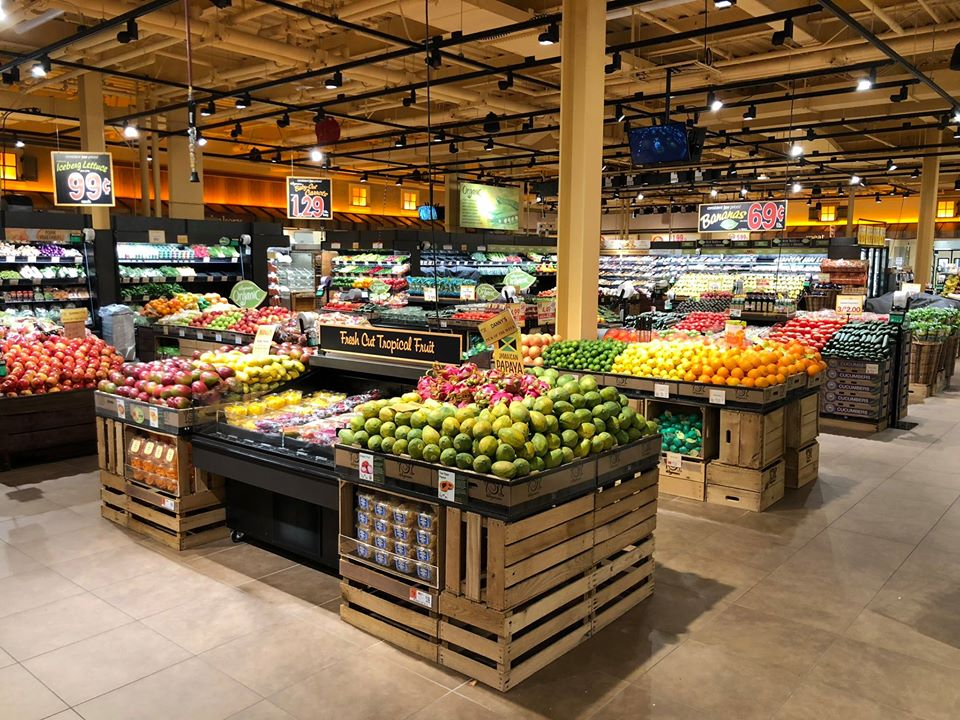 Displays of fruits and vegetables in a grocery store.