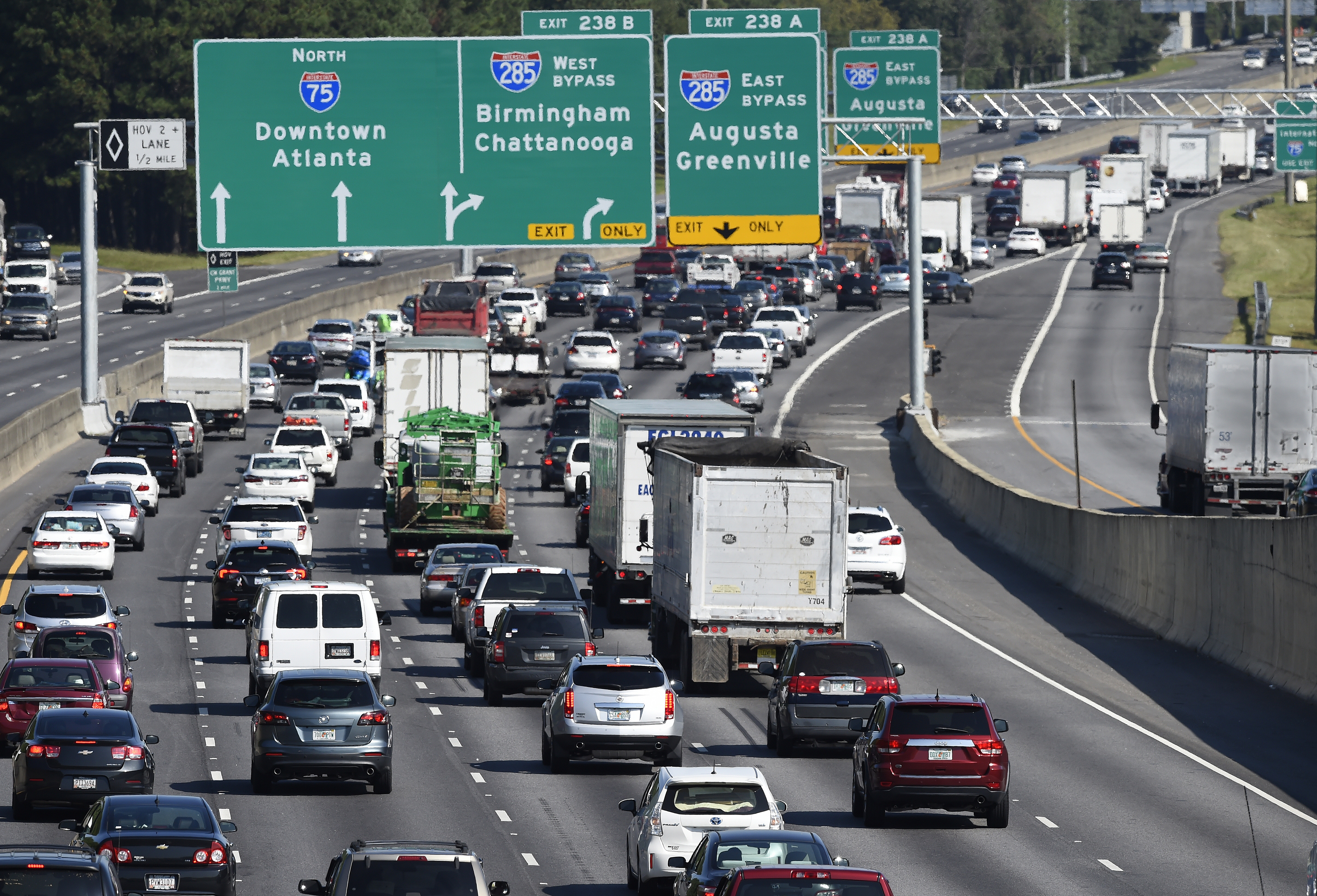 A busy Atlanta interstate with traffic in many lanes.
