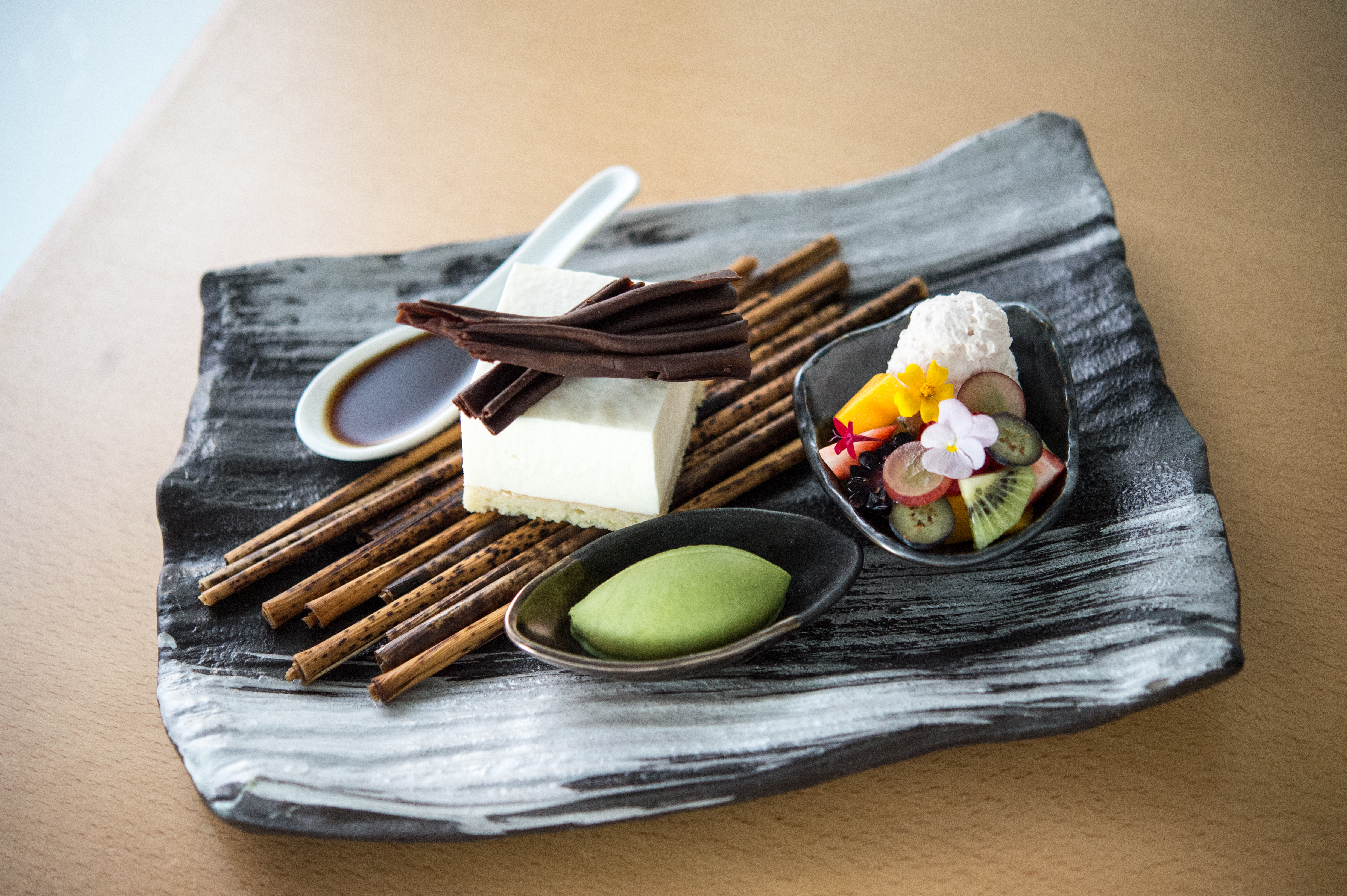 A dessert dish of tofu cheesecake and green tea ice cream at Morimoto