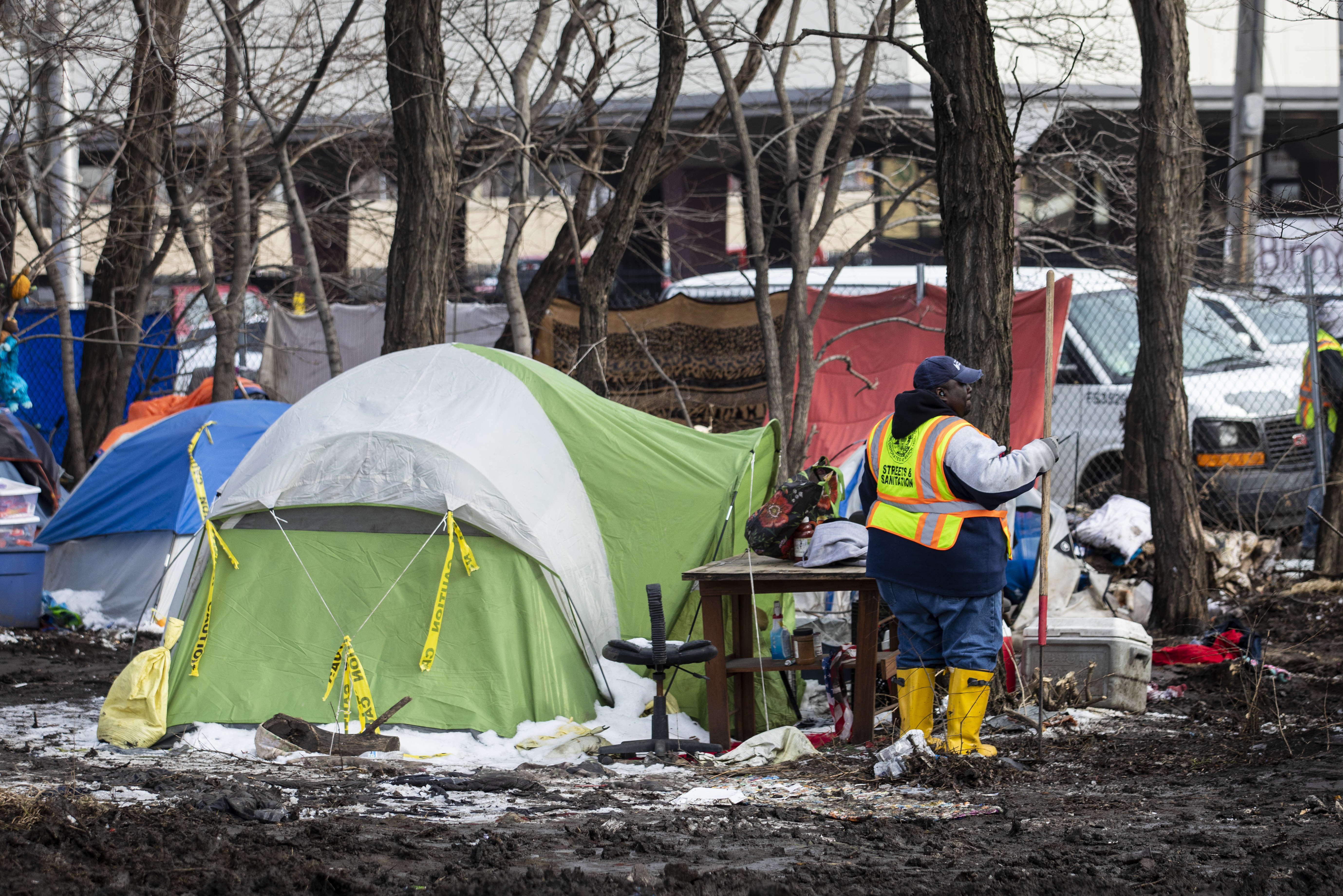 Workers from the city's Department of Streets and Sanitation clear out a homeless encampment near South Desplaines Street and West Roosevelt Road.