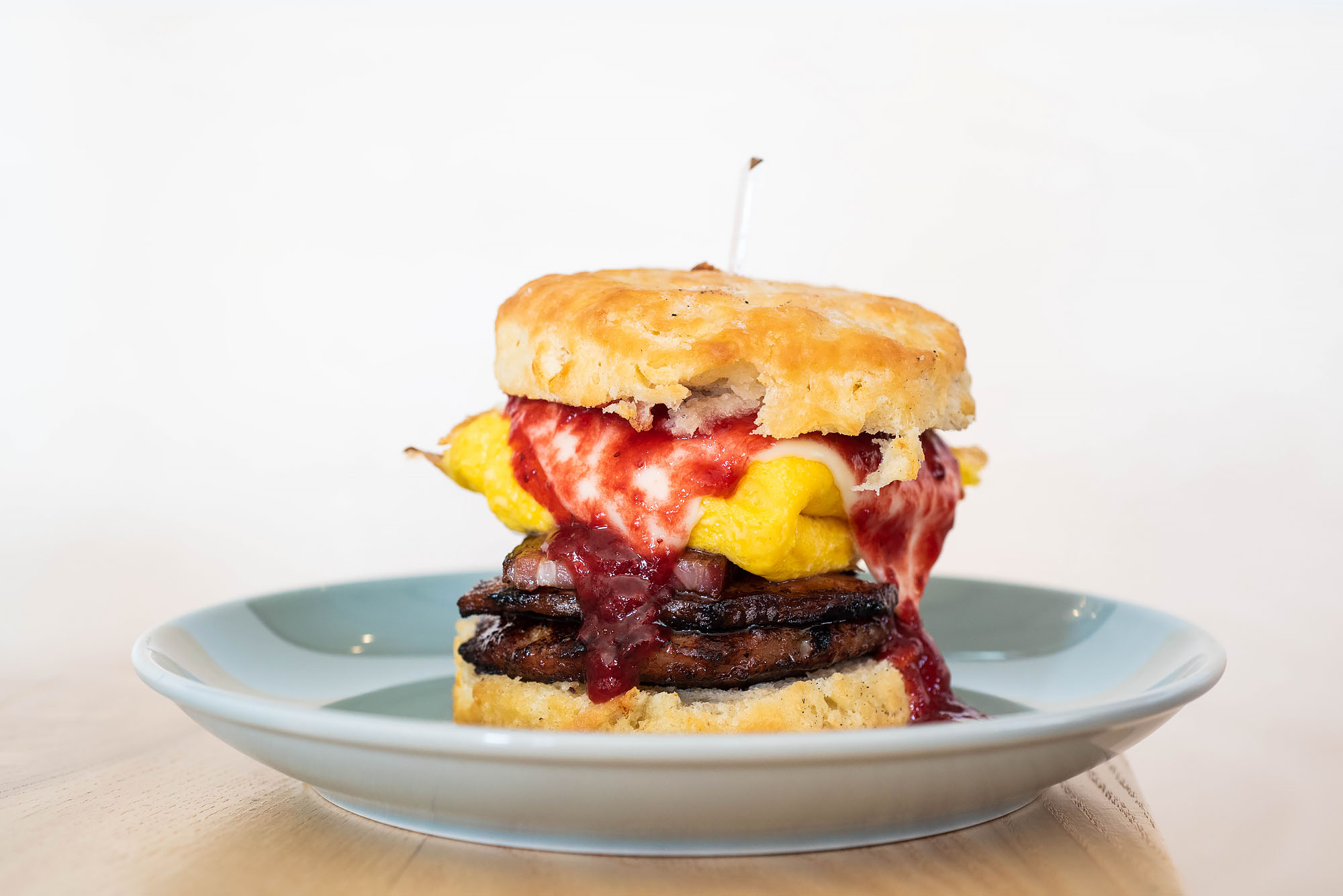 A breakfast sandwich on a biscuit at All Day Baby