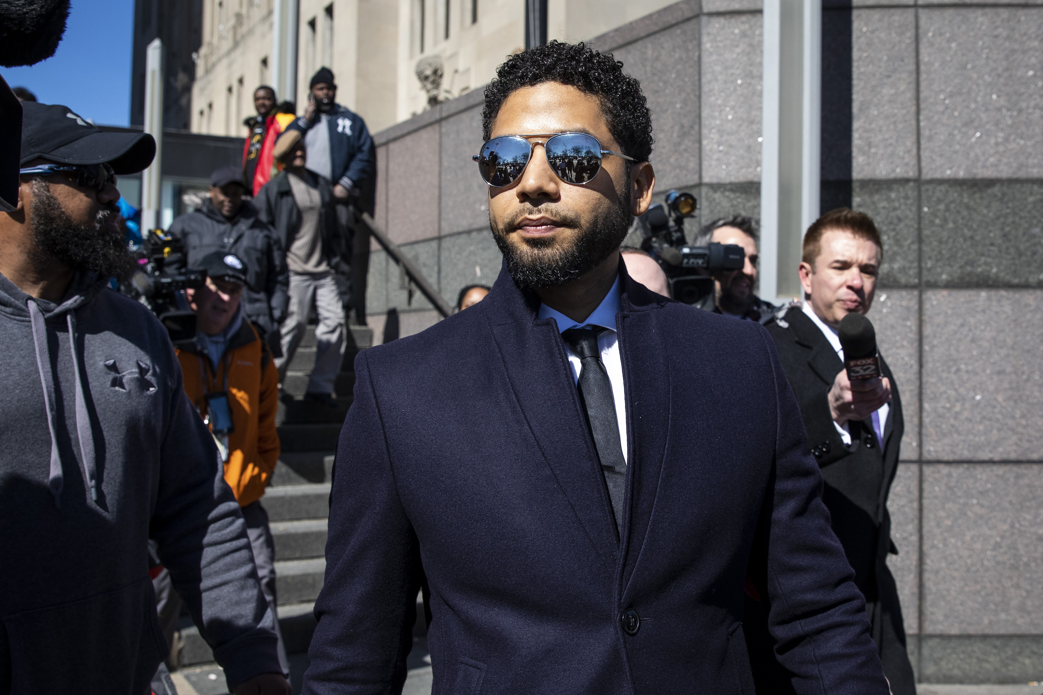Actor Jussie Smollett leaves the Leighton Criminal Courthouse after prosecutors dropped all charges against him.