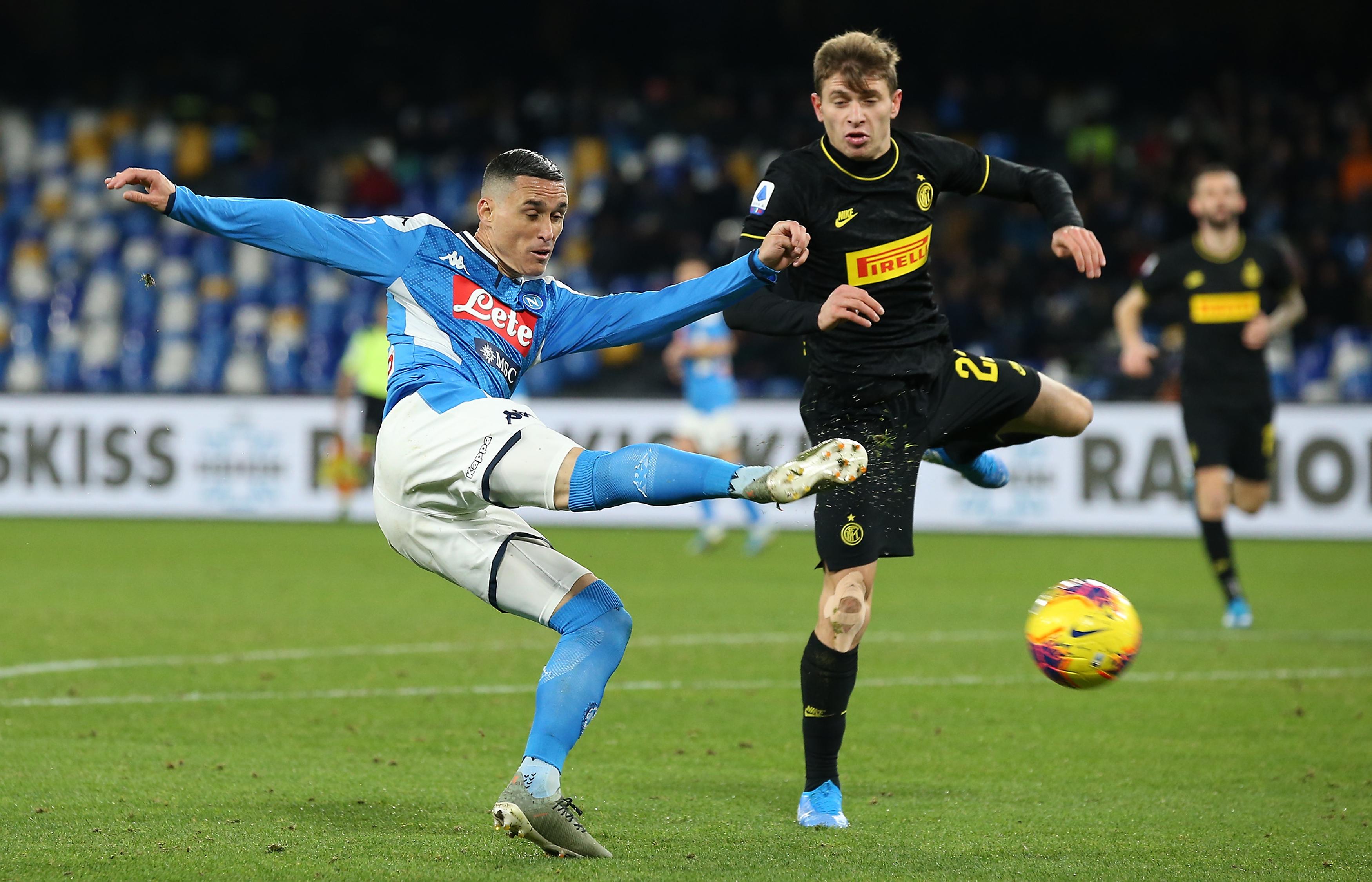 Napoli's Spanish striker Jose Maria Callejon (L) fights for...