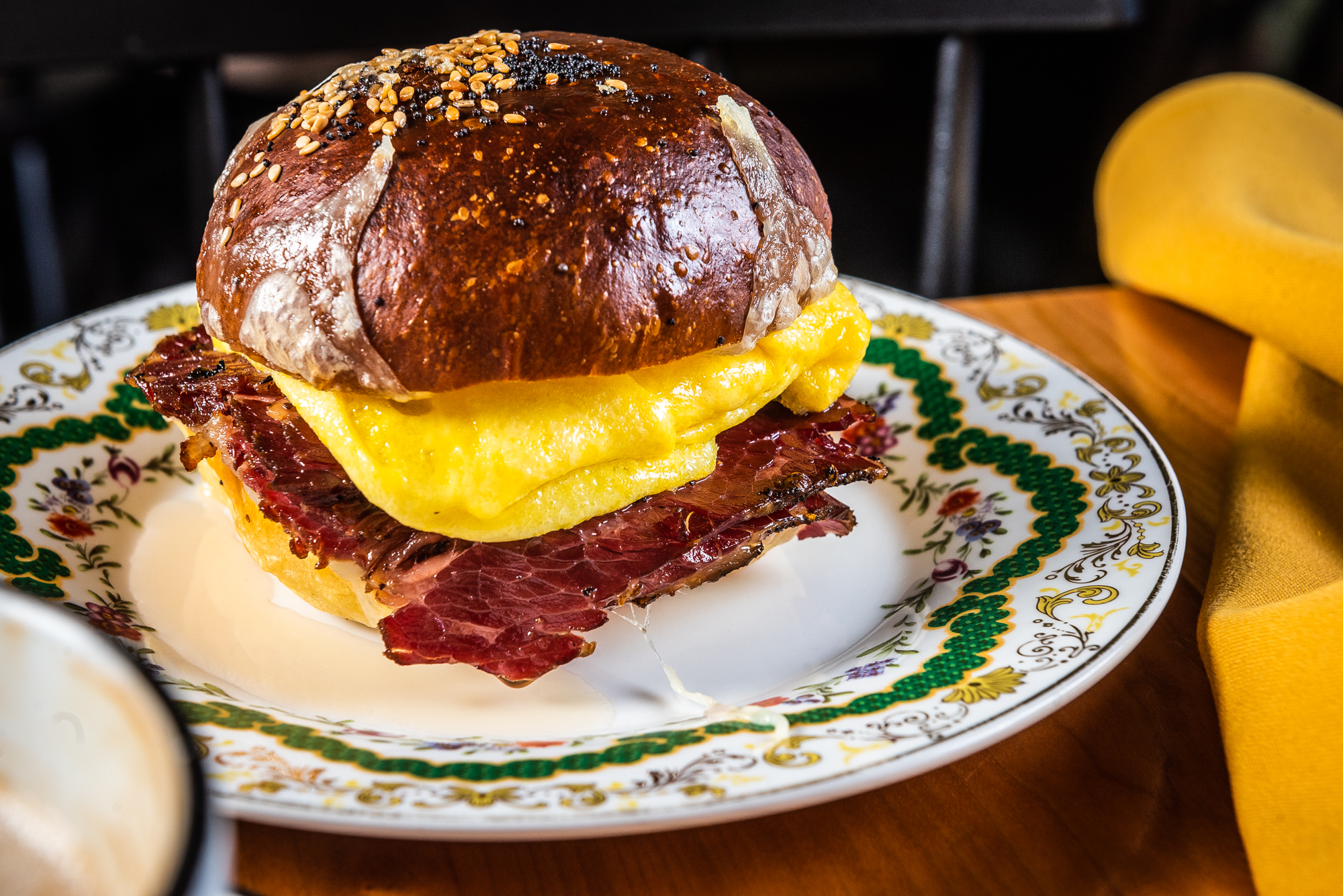 A pastrami breakfast sandwich from Ellē
