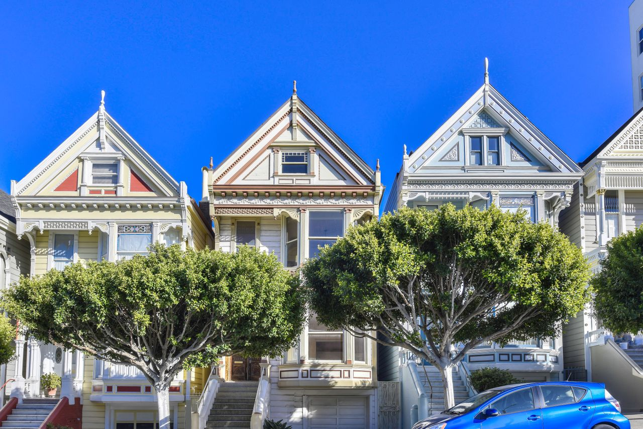 Three homes with peaked roof tops.