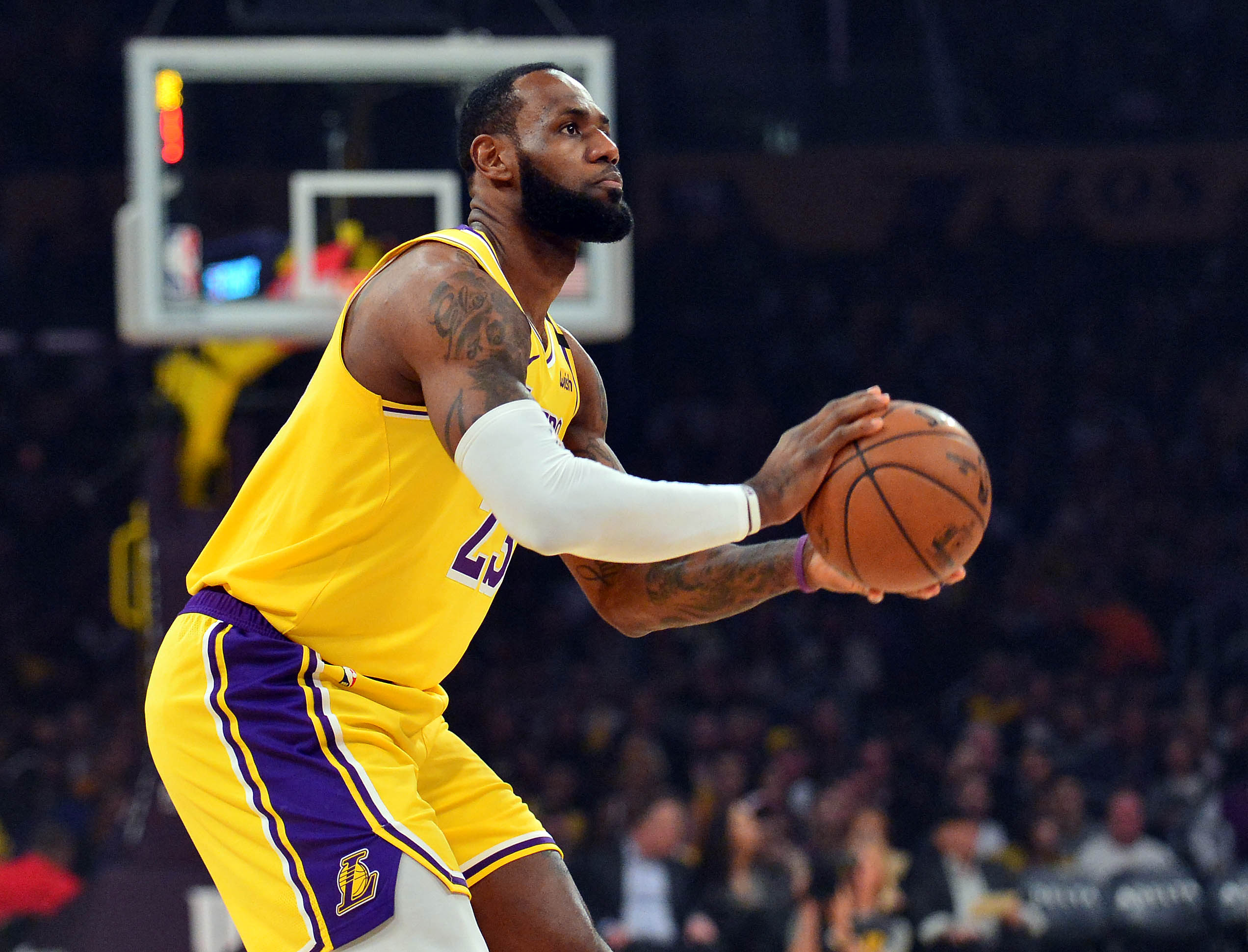 Los Angeles Lakers forward LeBron James shoots against the Phoenix Suns during the first half at Staples Center.