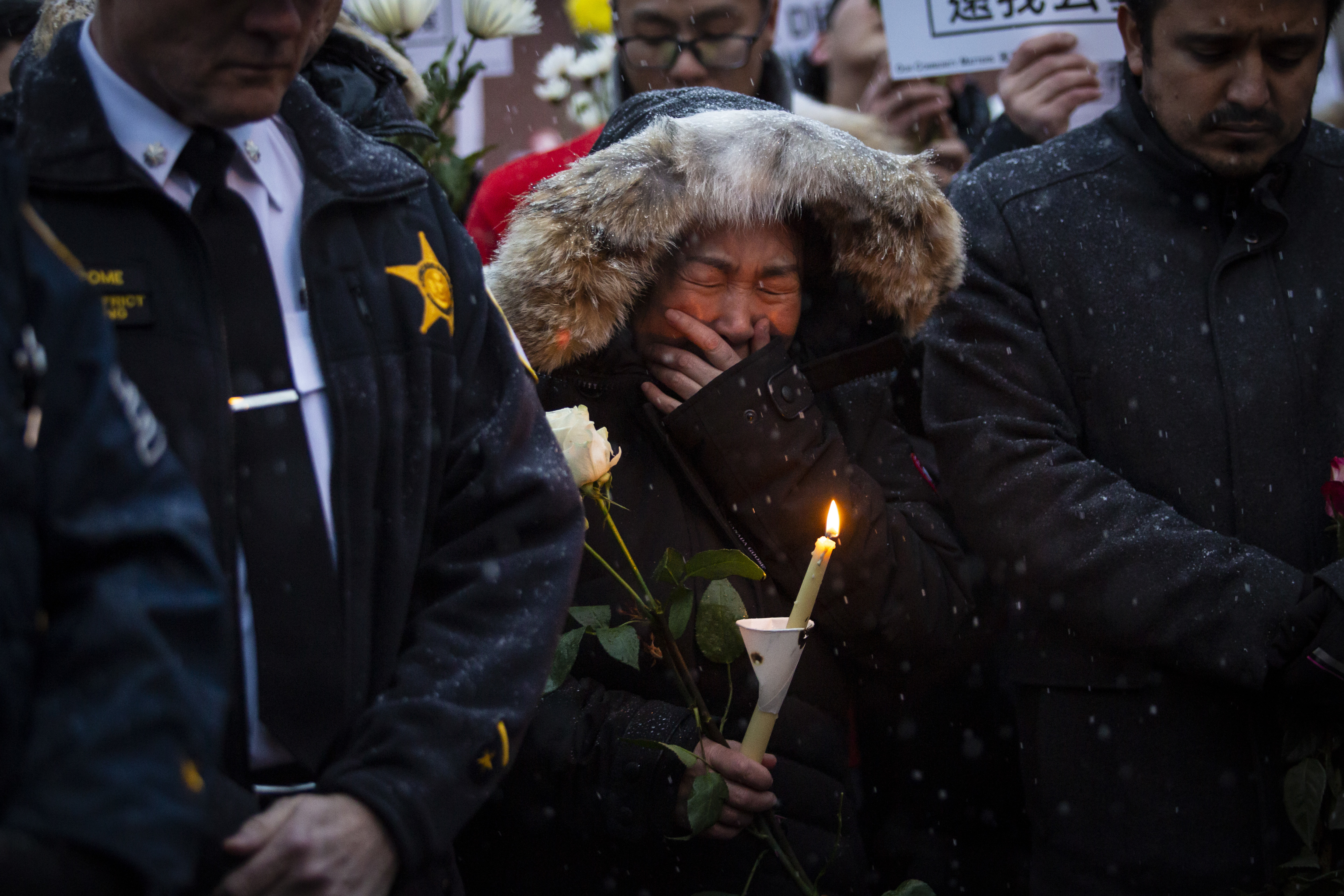 A woman cries as hundreds of mourners gather for a vigil Wednesday, Feb. 12, 2020, in a parking lot in the 2000 block of South Wells in Chinatown, where Huayi Bian and Weizhong Xiong were shot to death last weekend. Bian and Xiong were killed during an apparent robbery, for which a suspect  faces two counts of first-degree murder.