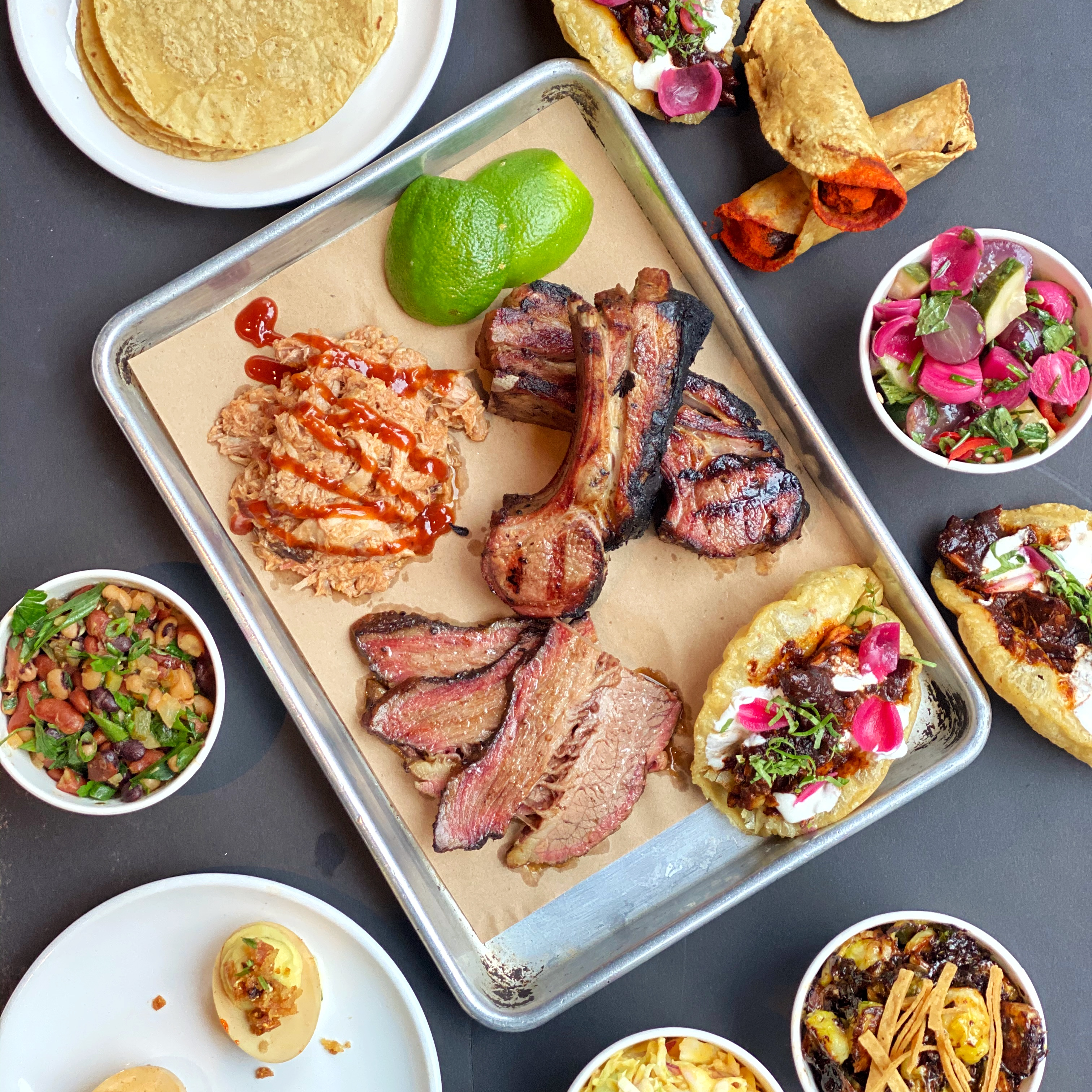 smoked meat and tacos on a tray