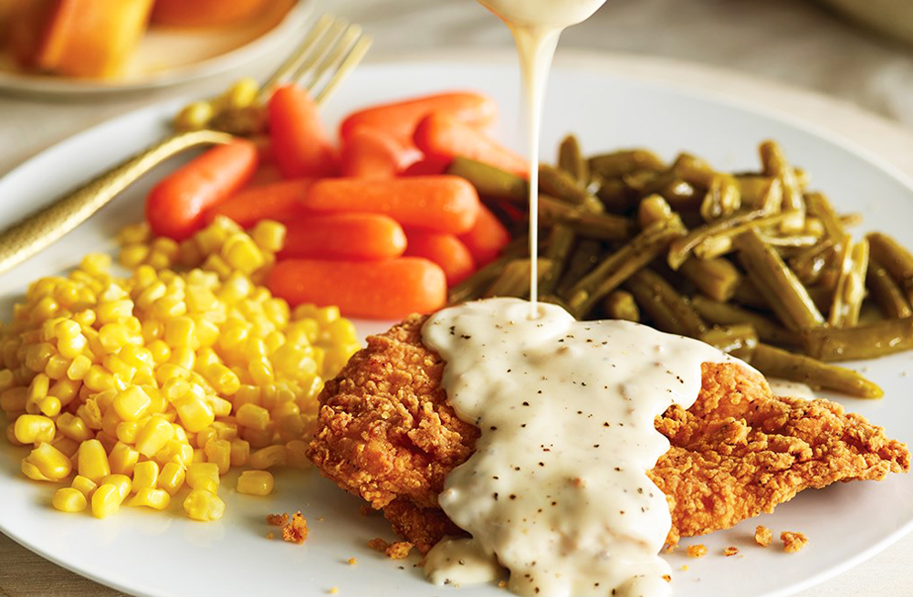 """A plate of Cracker Barrel's country-style """"fixin's"""" headed to Henderson."""