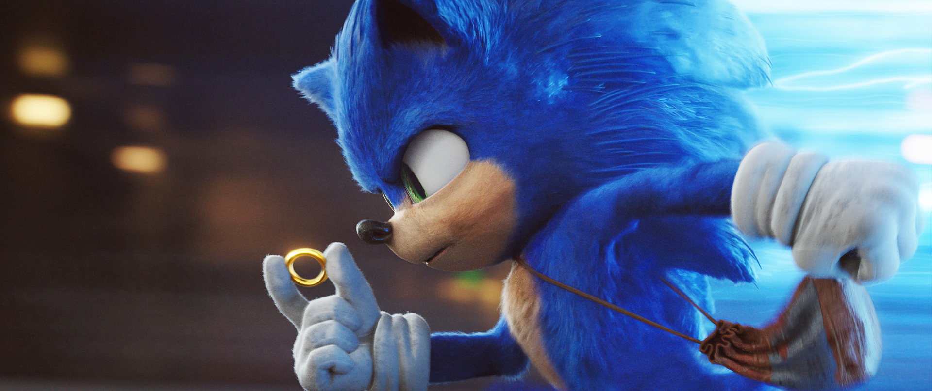 sonic holds a gold ring as he runs real fast