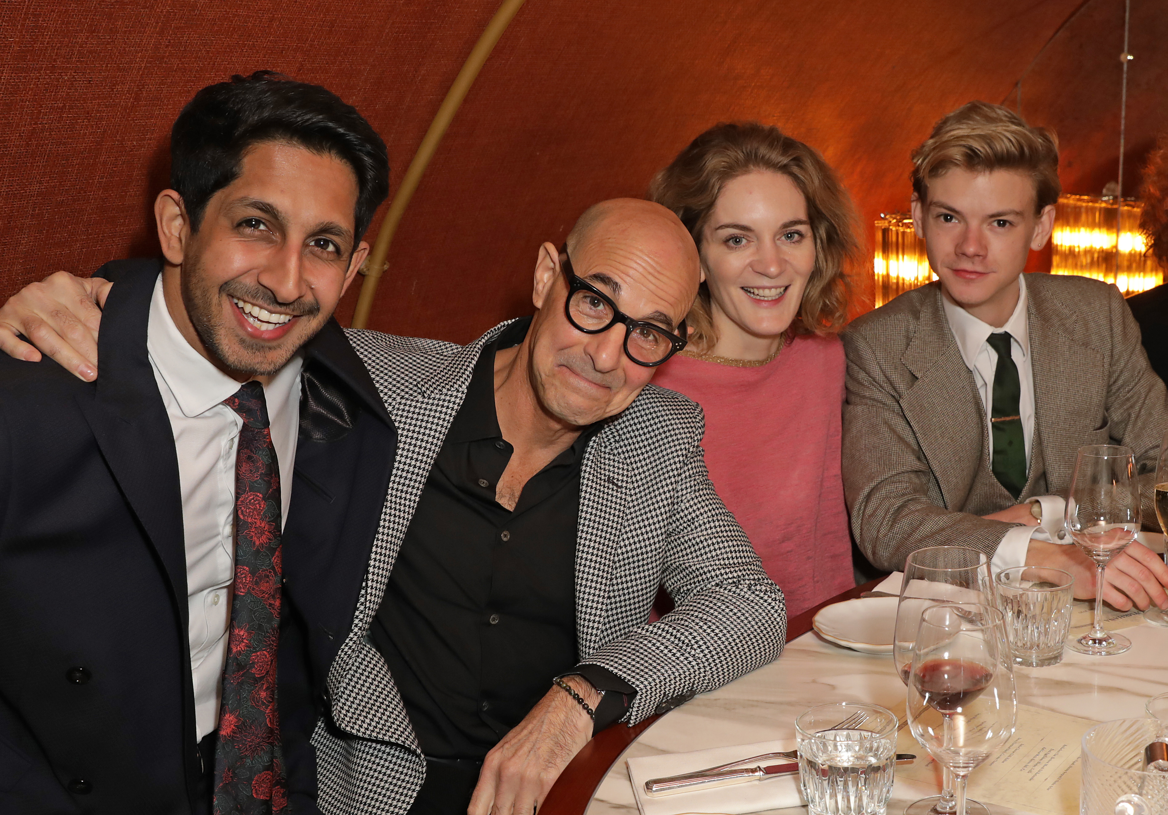 Stanley Tucci, Sagar Radia, Felicity Blunt, and Thomas Brodie-Sangster in a booth at Michelin-starred London restaurant Gymkhana