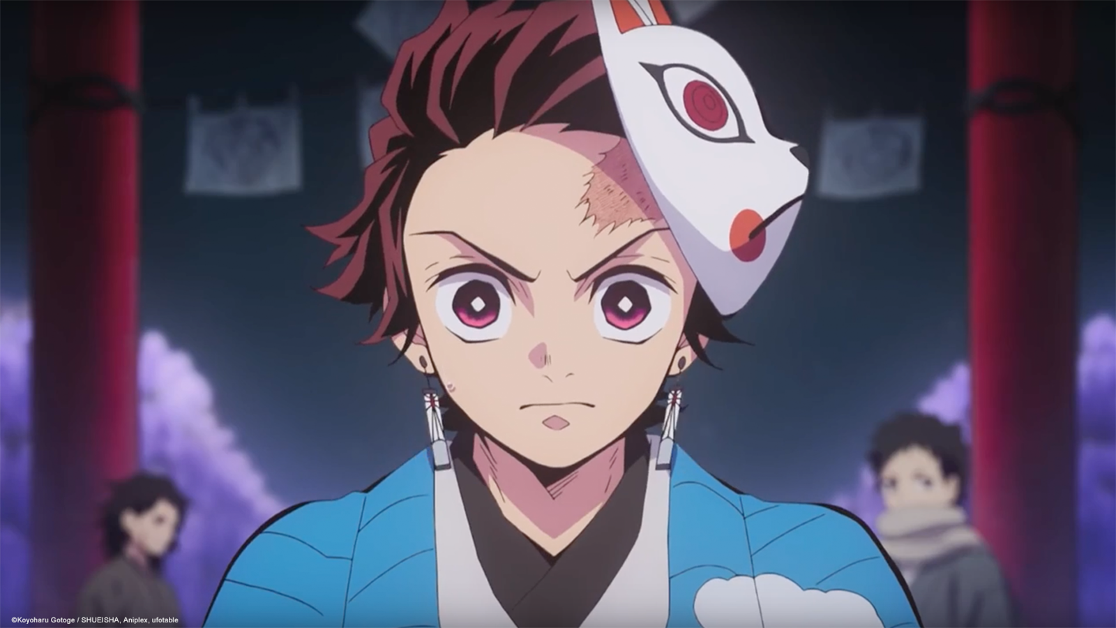 Tanjiro from Demon Slayer looks into forward with a mask on his head