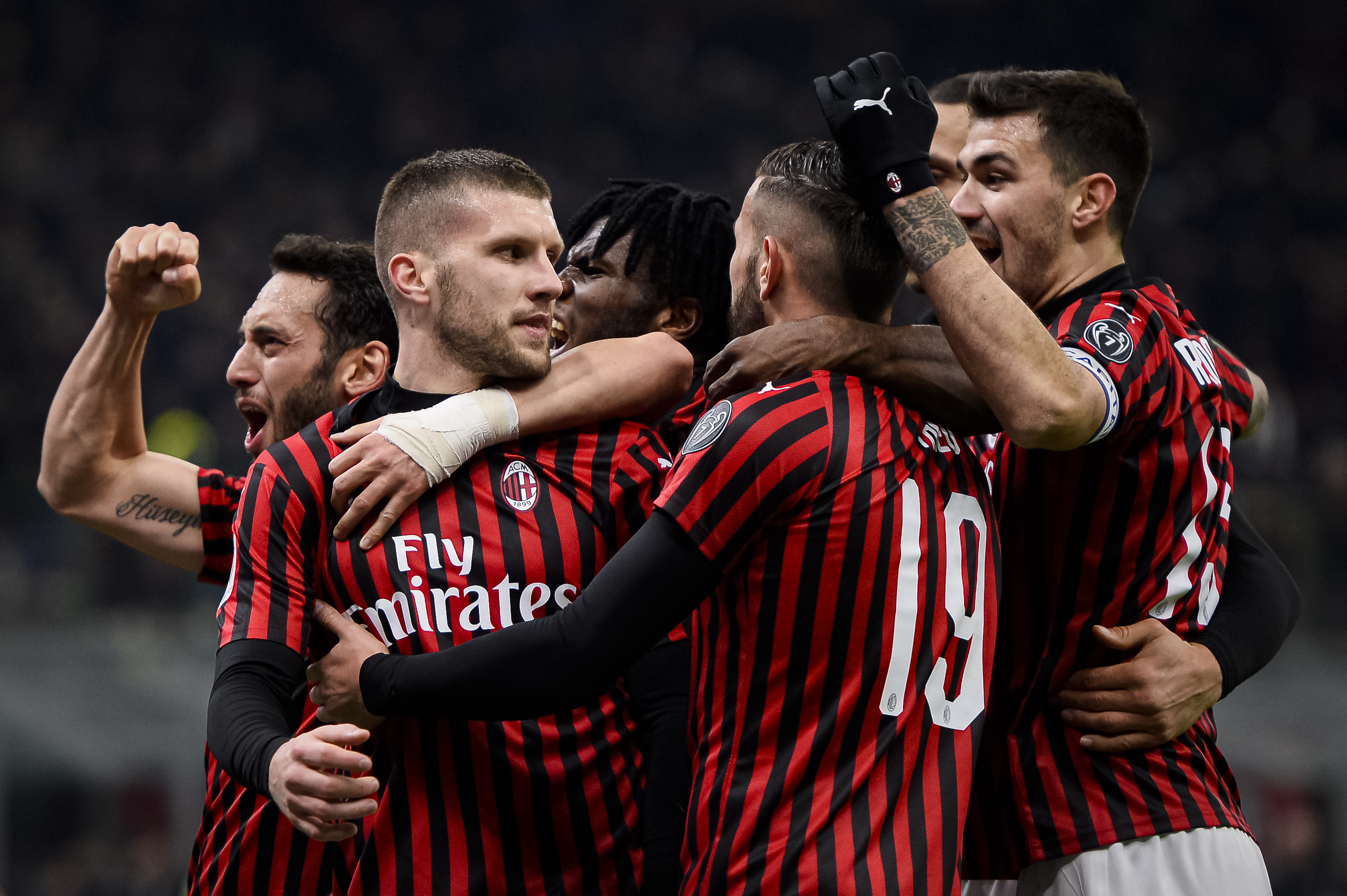 Ante Rebic (2nd from L) of AC Milan celebrates with his...