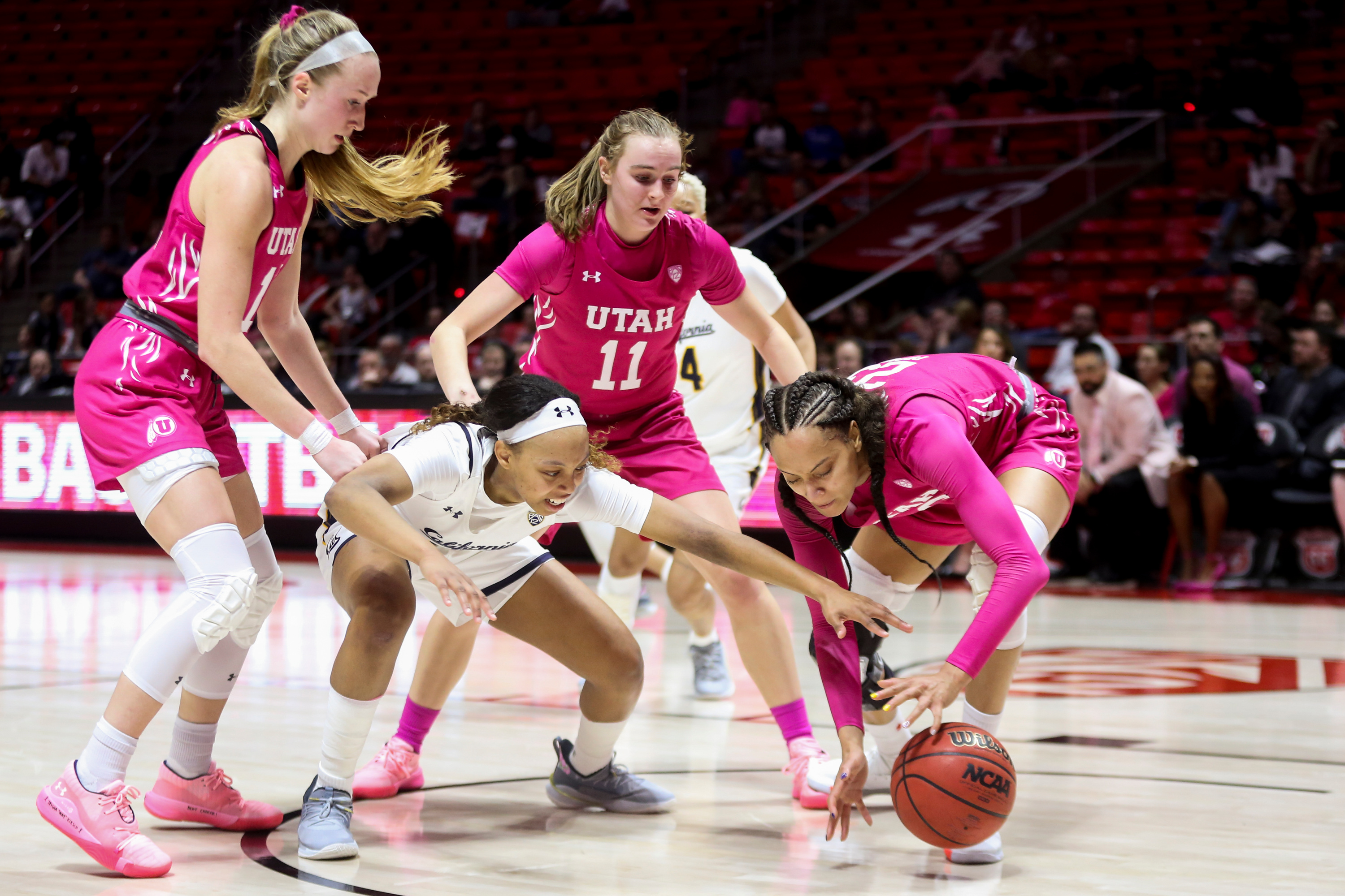 California Golden Bears guard Cailyn Crocker (2) attempts to steal the ball from Utah Utes guard Daneesha Provo (23) while guard Dru Gylten (10) and guard Brynna Maxwell (11) play offense at the Jon M. Huntsman Center in Salt Lake City on Sunday, Feb. 16, 2020.