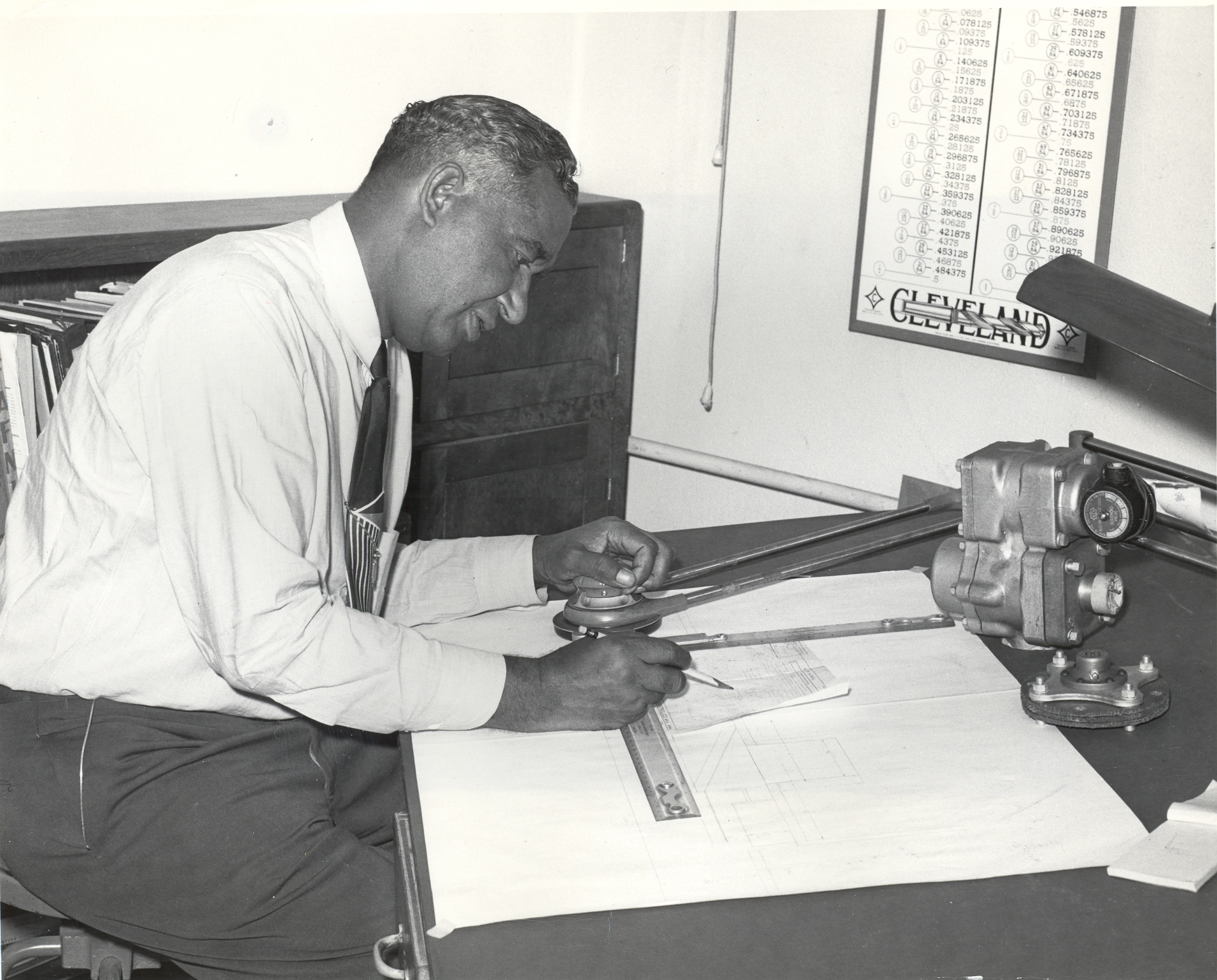 Frederick McKinley Jones at his drafting desk. Jones was a prolific inventor who invented a cooling system used in Army trucks in World War II to transport food, medicine and blood.