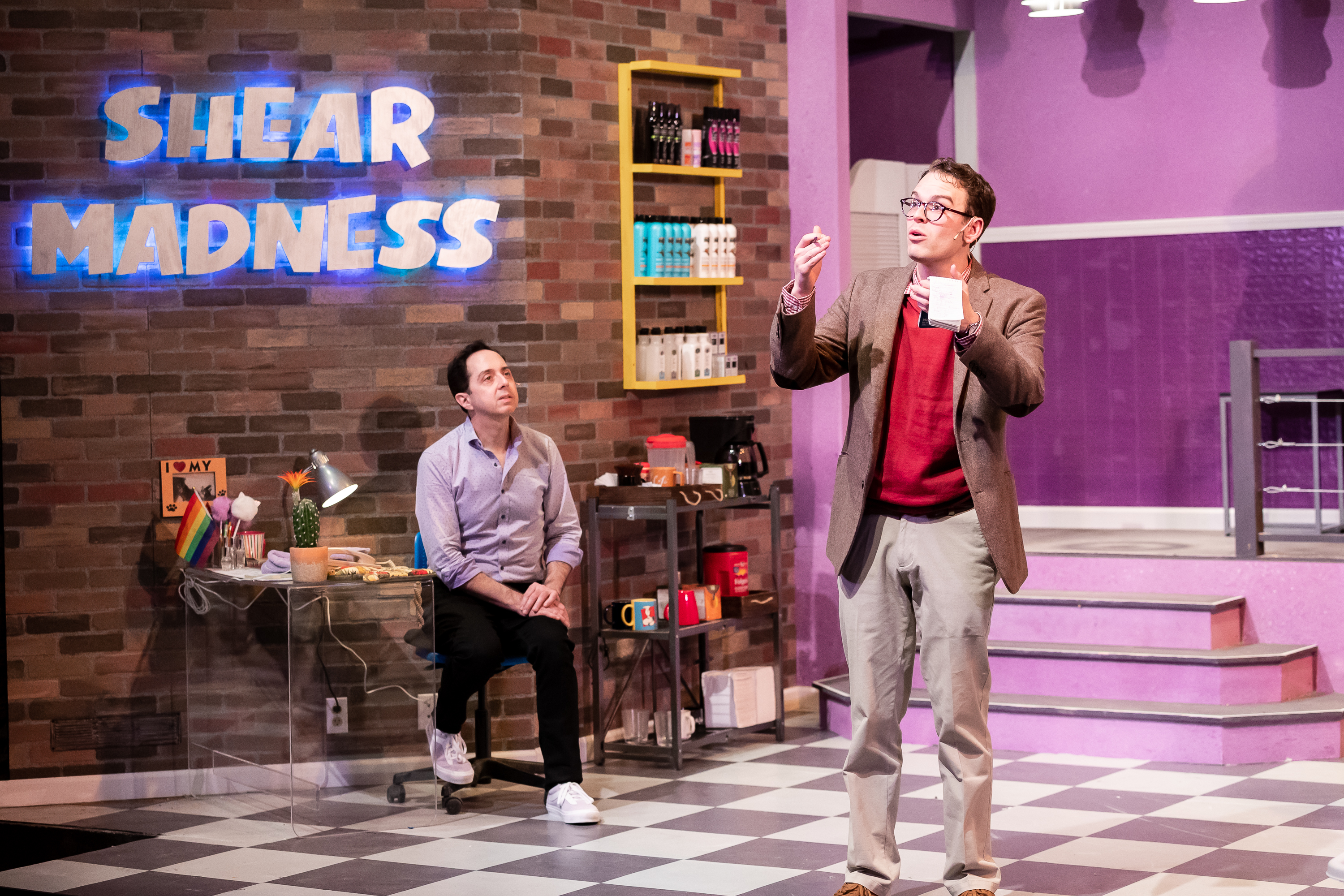 "Salon owner Tony Whitcomb (Ed Kross, left) is questioned by detective Mikey Thomas (Sam Woods) in a scene from ""Shear Madness"" at the Mercury Theater."