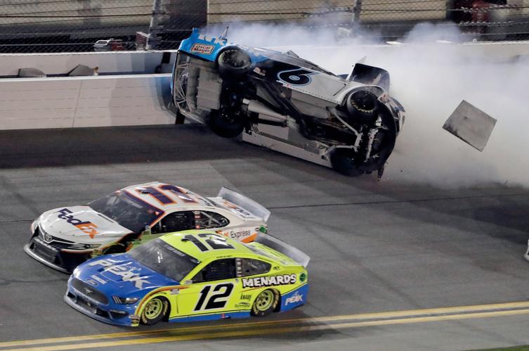 Ryan Newman (6) crashes as Denny Hamlin (11) and Ryan Blaney (12) battle on the final lap of the Daytona 500 on Monday in Daytona Beach, Fla.