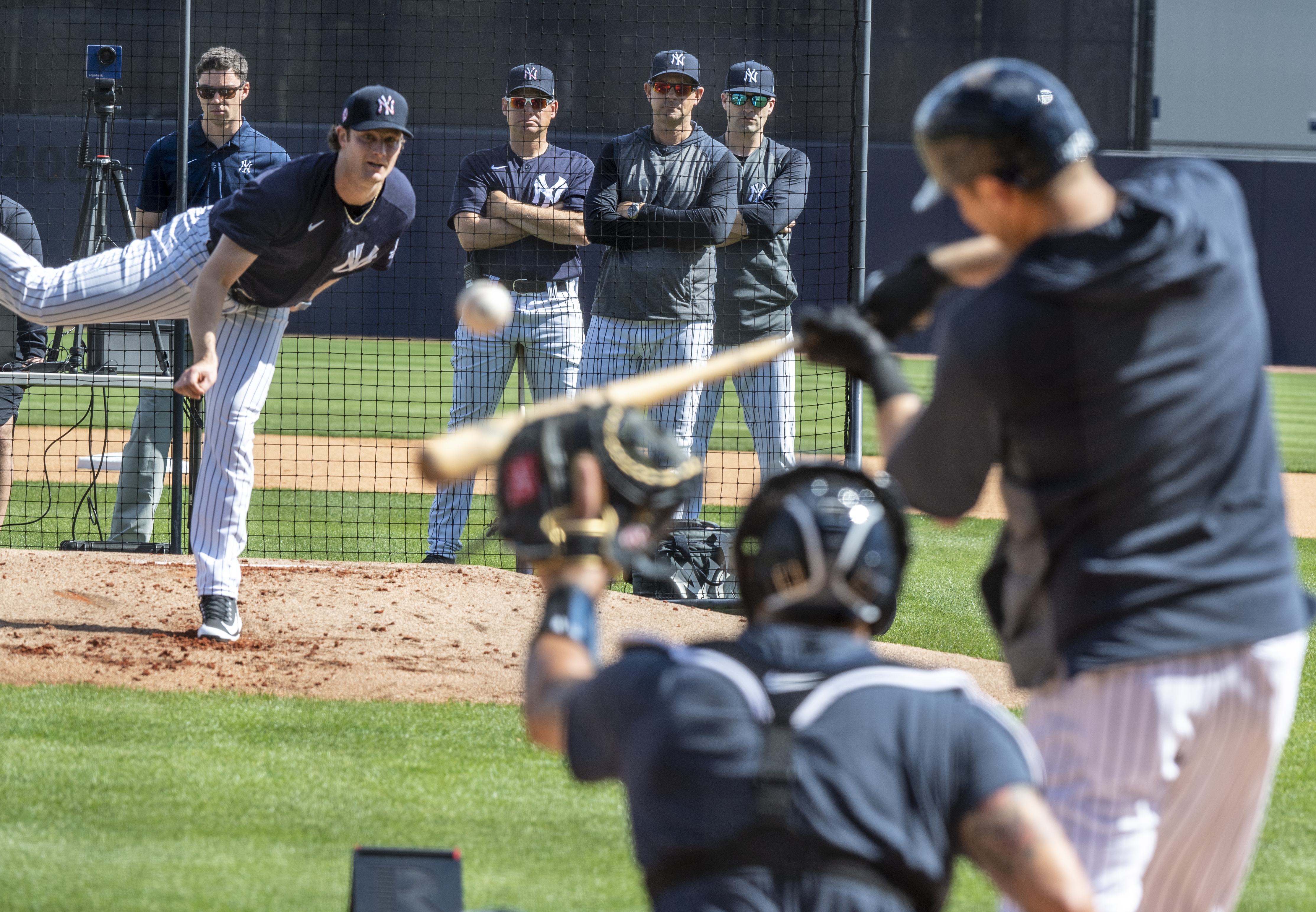 New York Yankees pitcher Gerrit Cole, manager Aaron Boone, and coach Carlos Mendoza at spring training